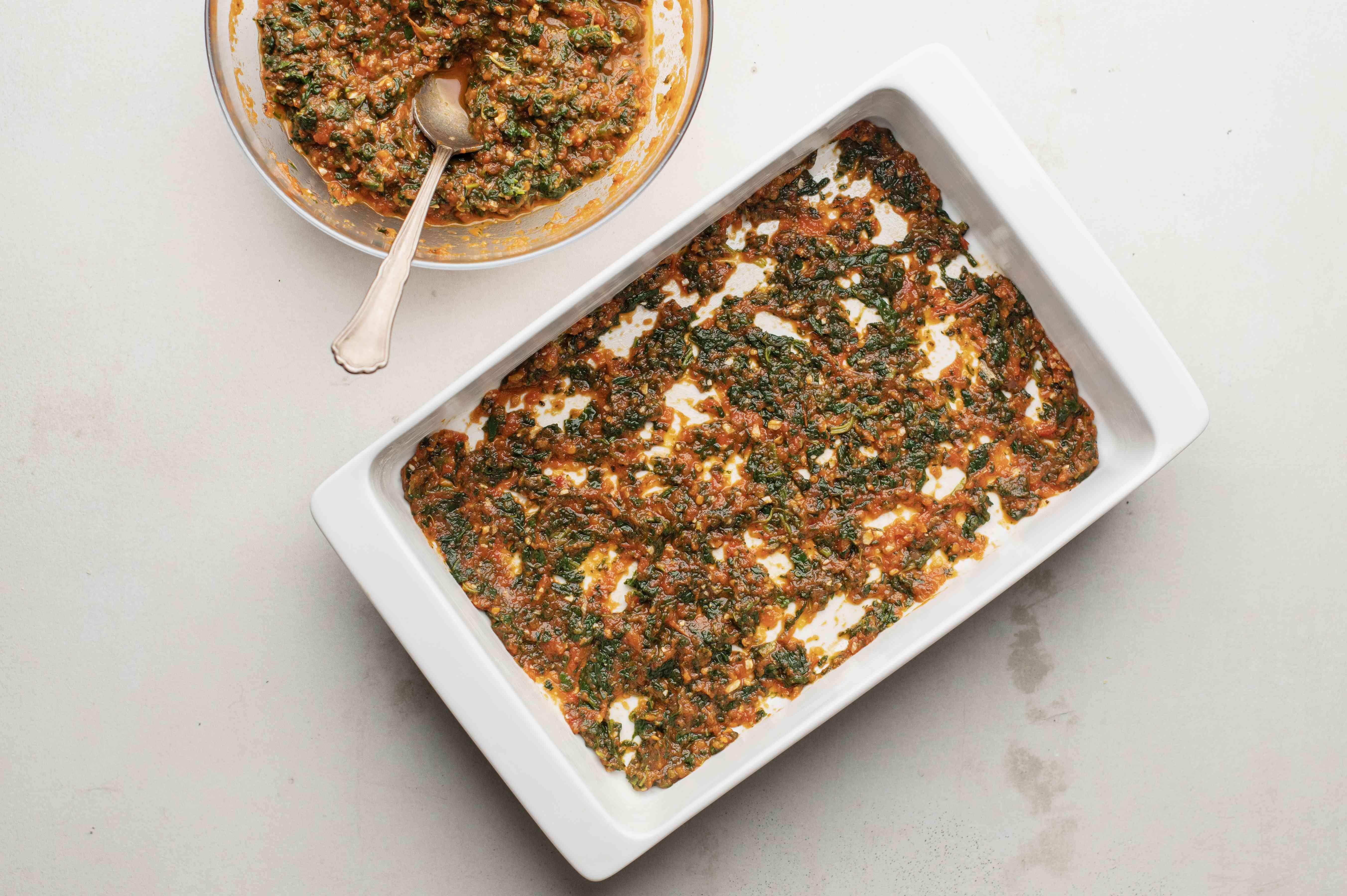 Spread spinach and marinara across the bottom