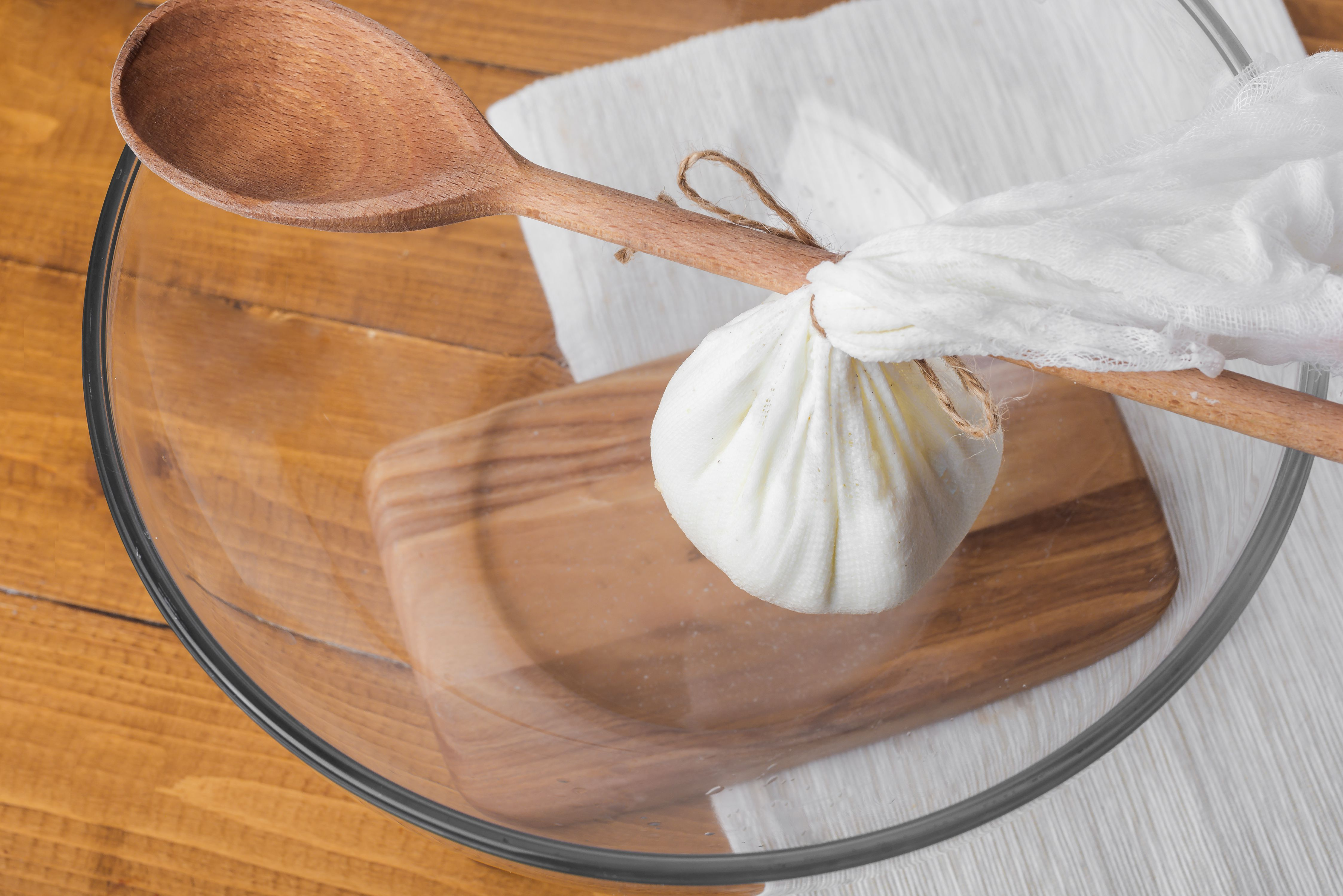 Hang the cheesecloth bundle over bowl