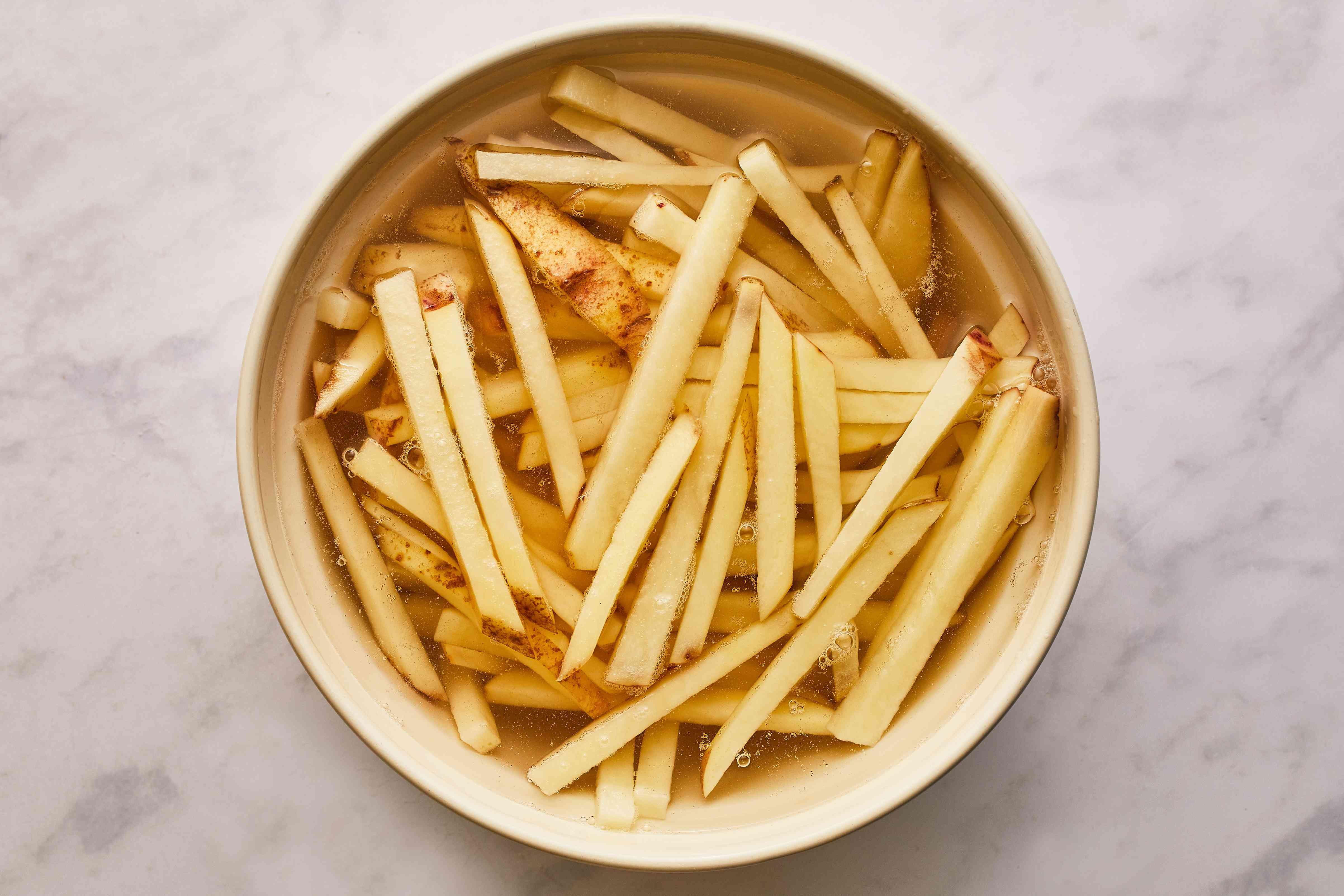 Soaking potatoes for fries