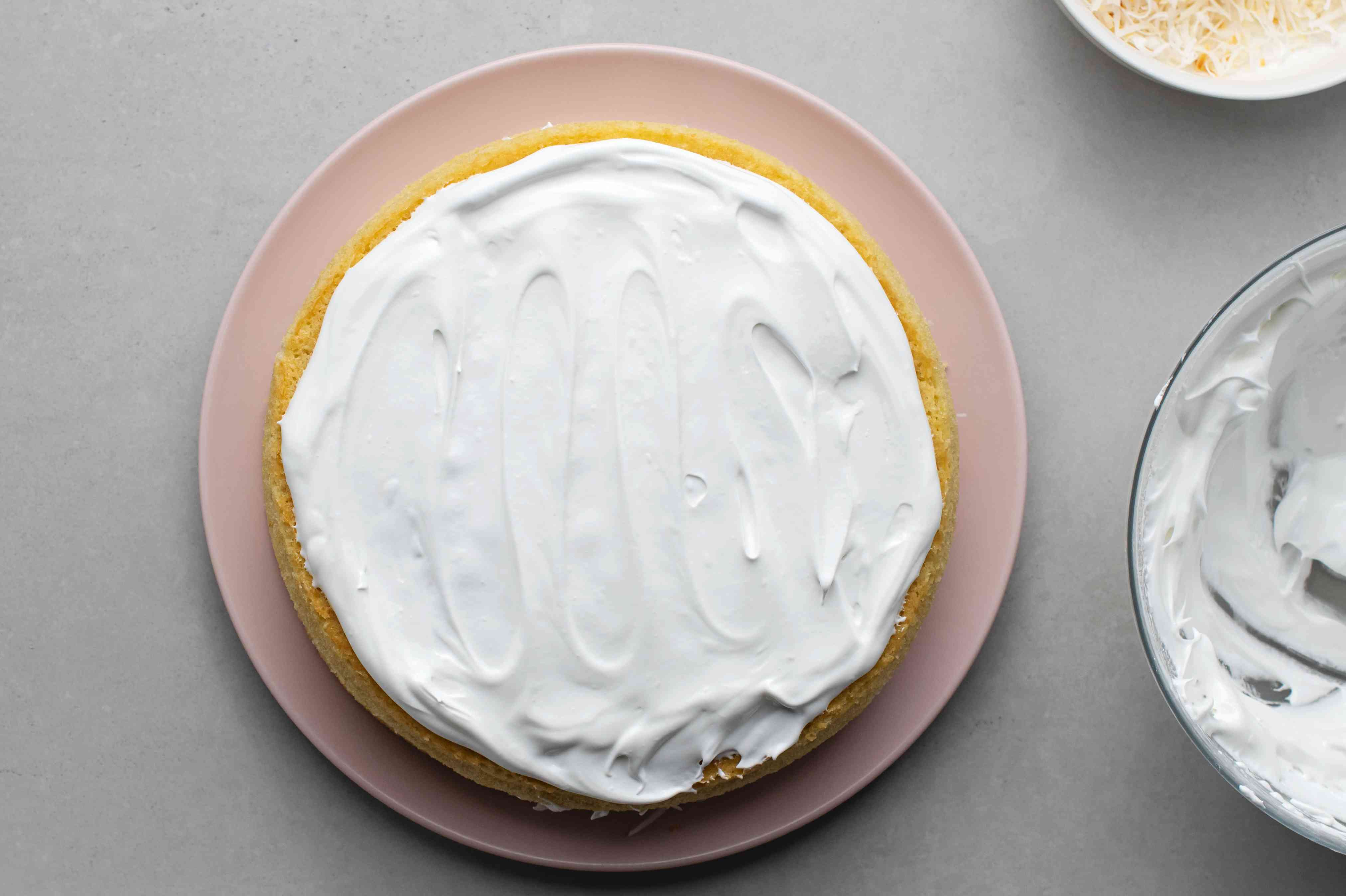 layer of coconut cake with coconut icing