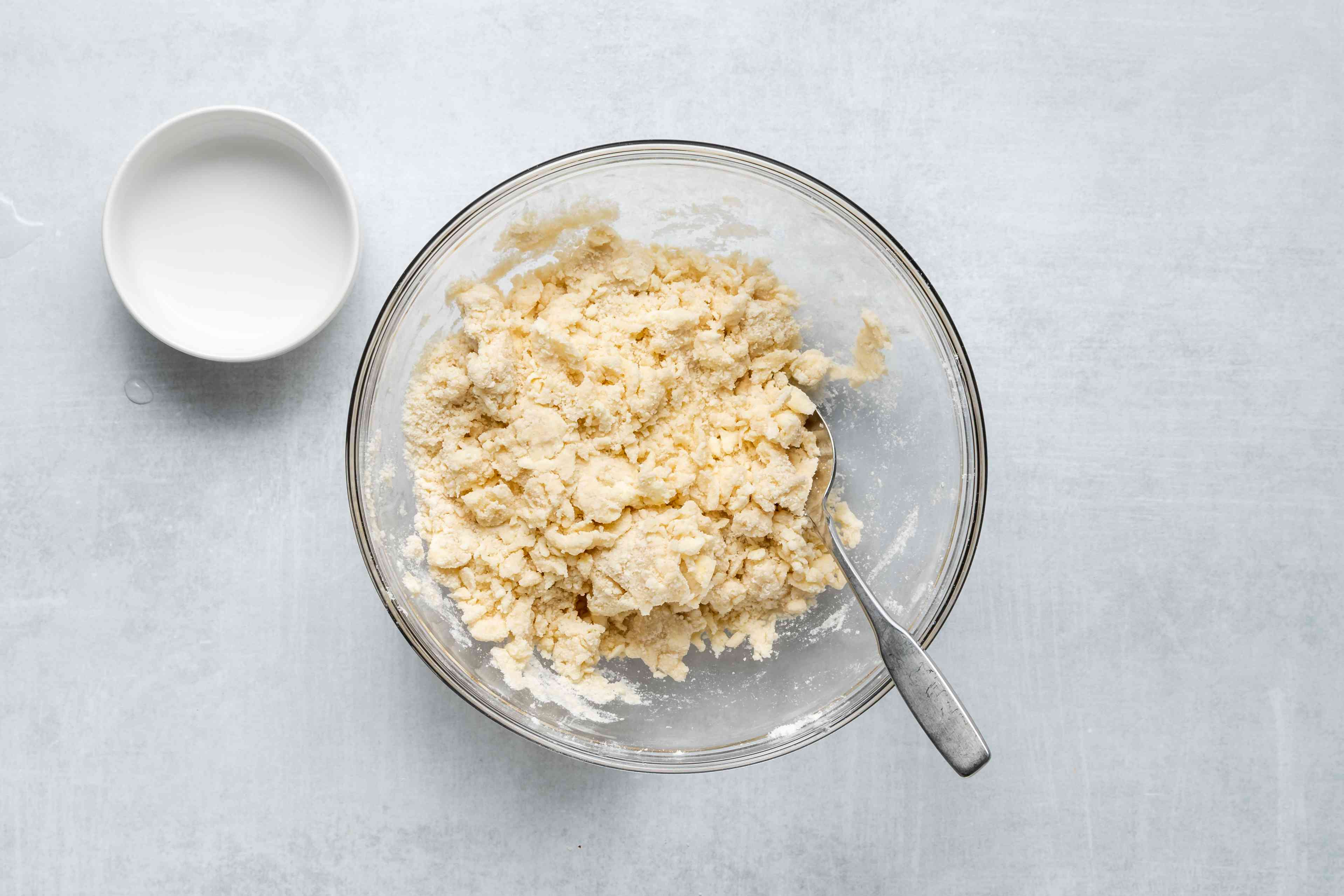 add water to flour mixture in the bowl