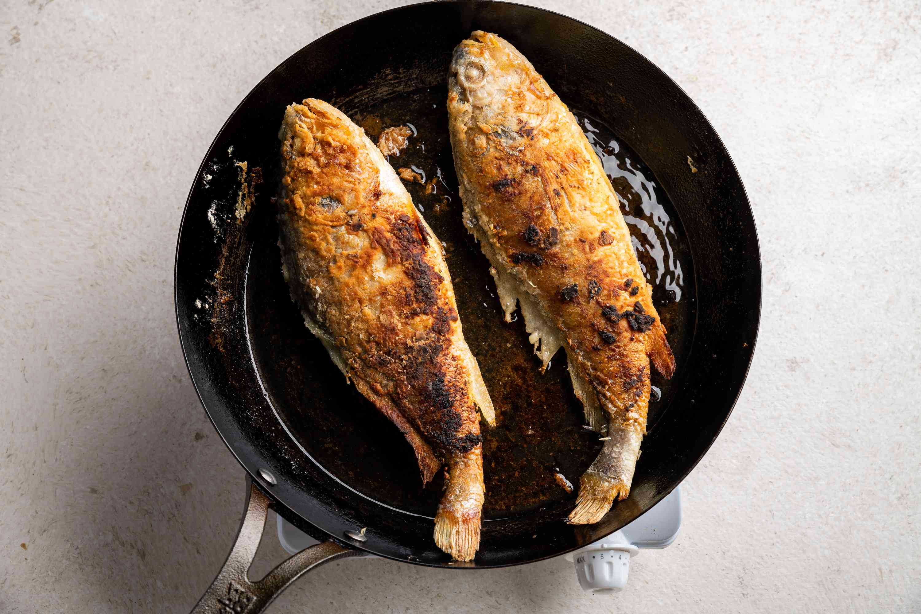 fried whole fish in a pan