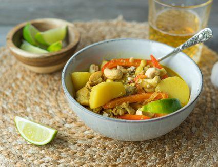 Serve Thai Massaman Chicken Curry with garnish and rice
