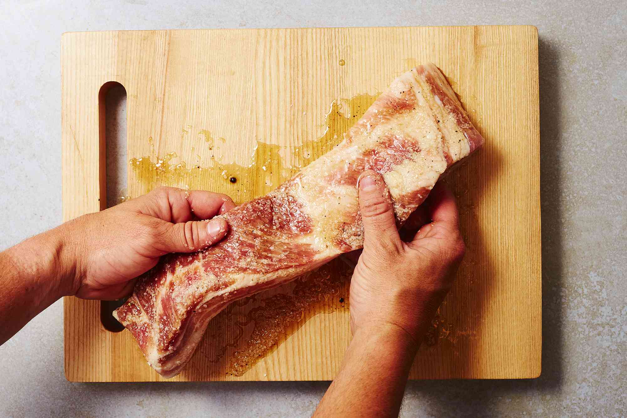 Rub the seasoning mixture into all sides of the pork belly