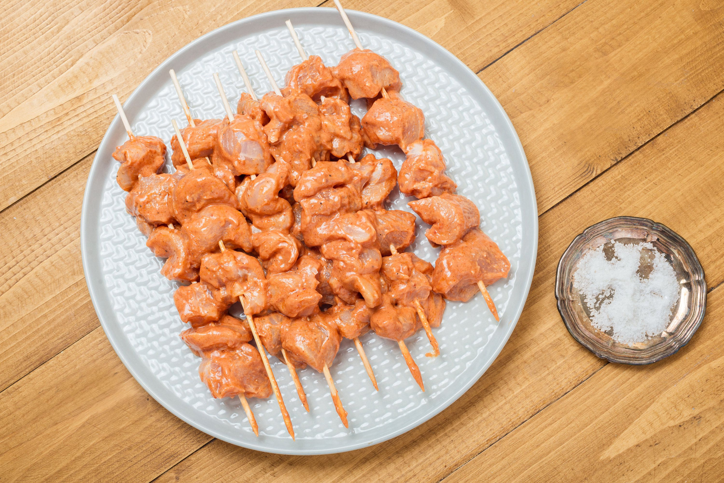 Turkish chicken kebabs on a plate, ready to cook