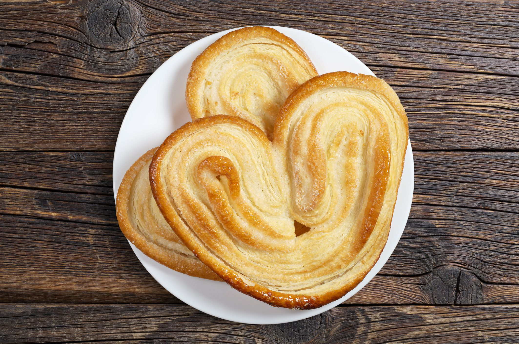Puff pastry hearts on plate