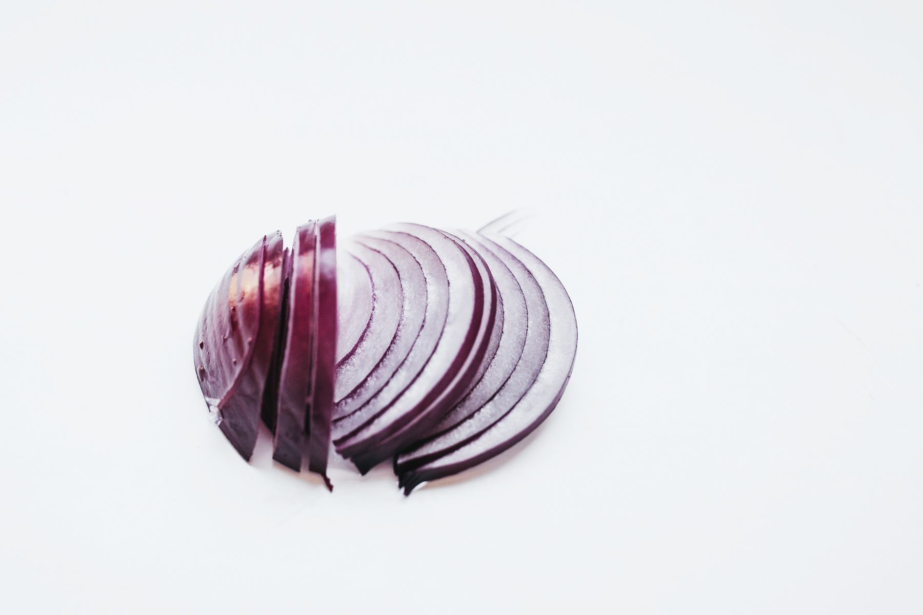 Peel and slice red onion
