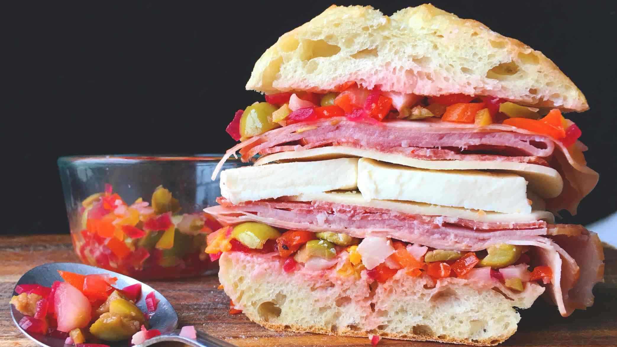 Muffuletta sandwich in a fresh roll