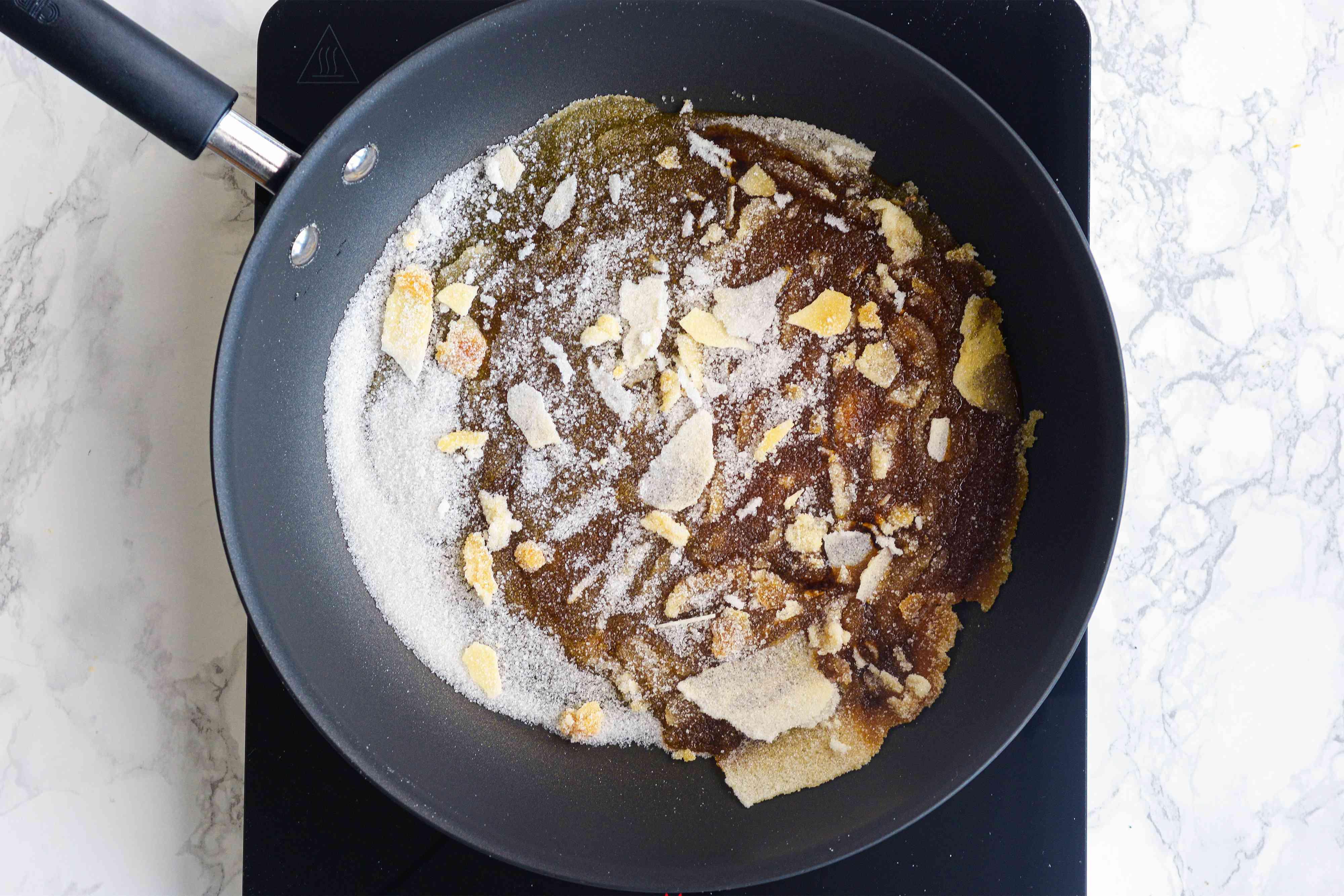 Sugar turning to caramel in a pan