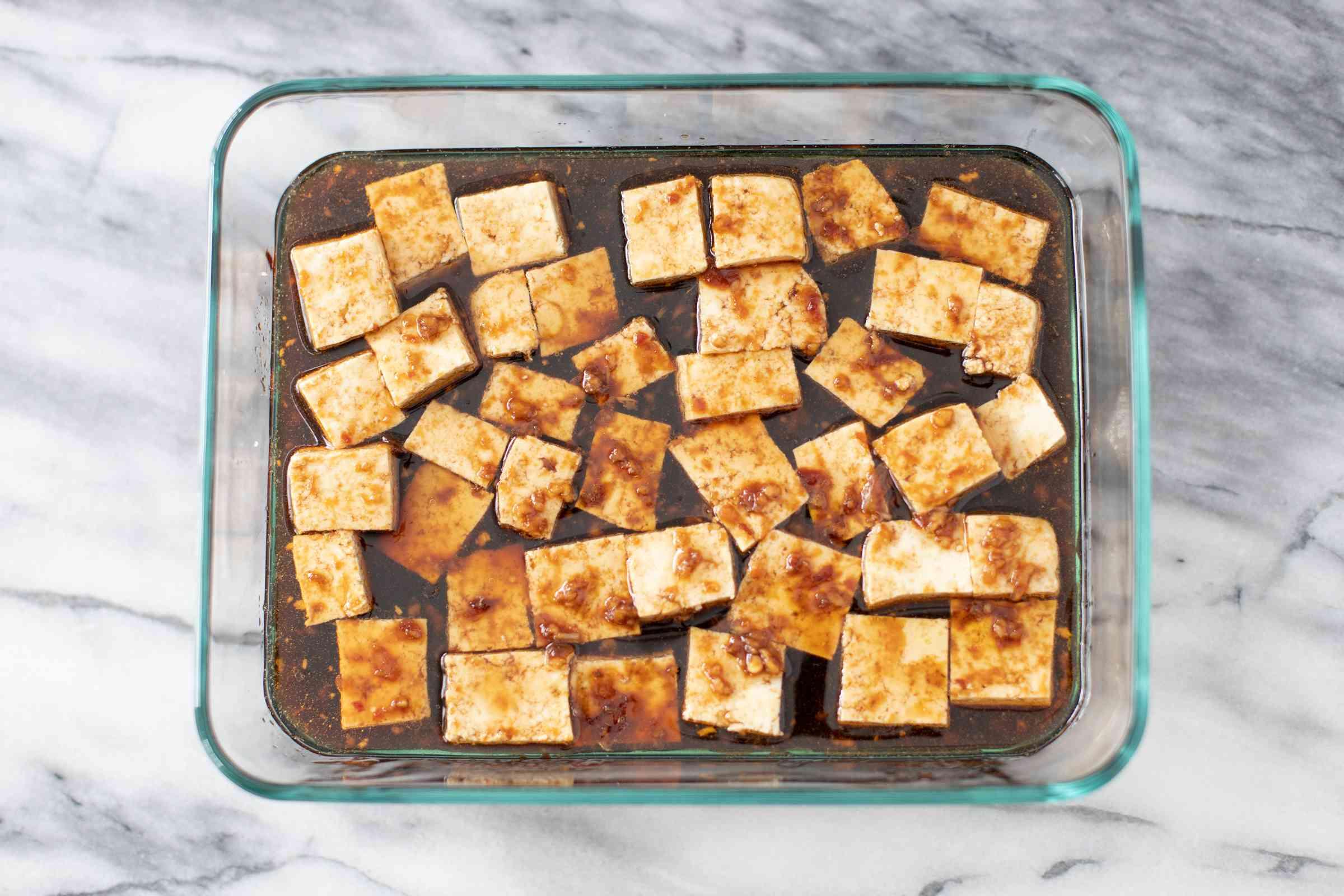 tofu cubes marinating in dish