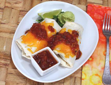 Chicken burritos with salsa.