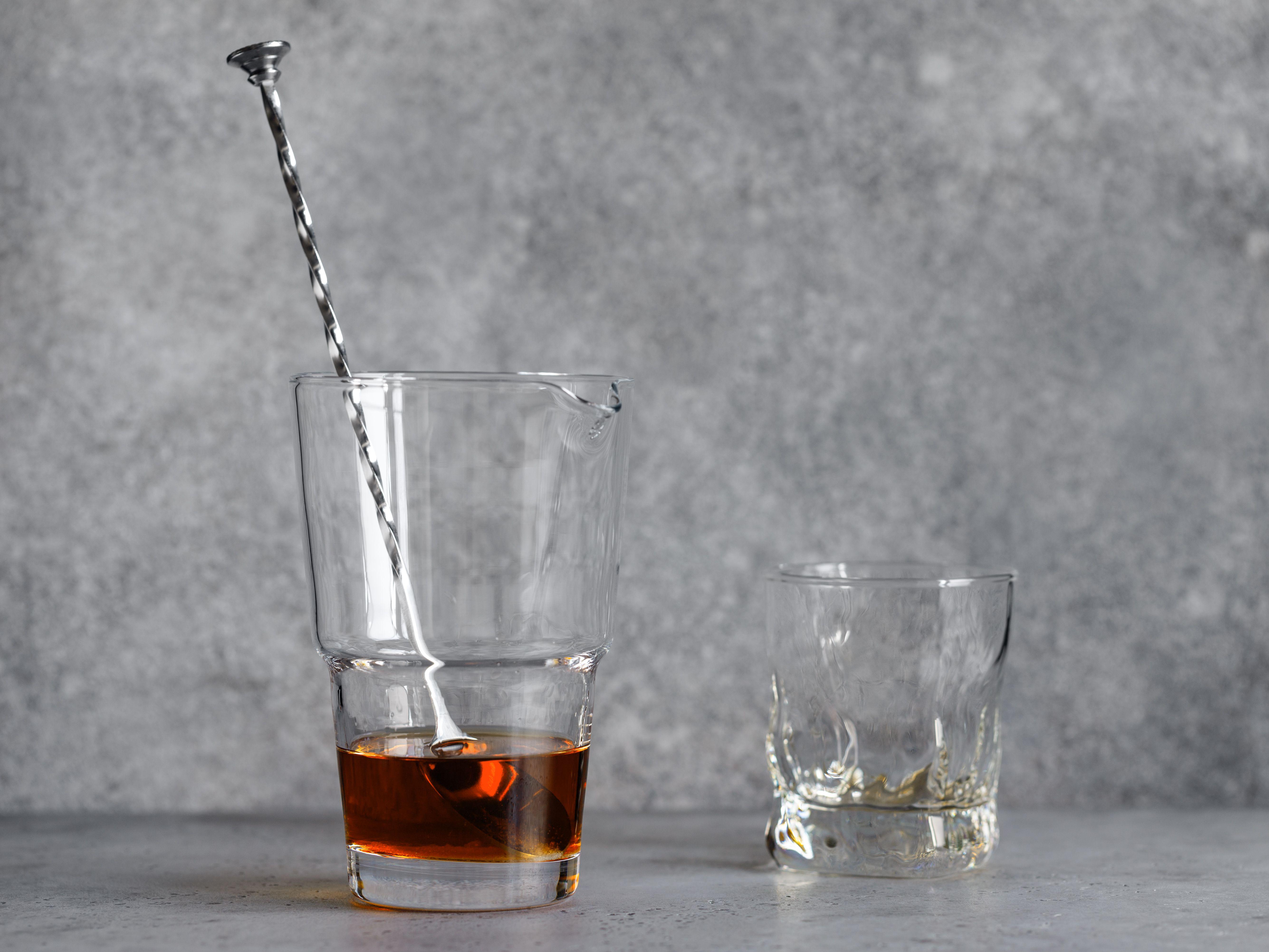 Stir rye whiskey into the glass