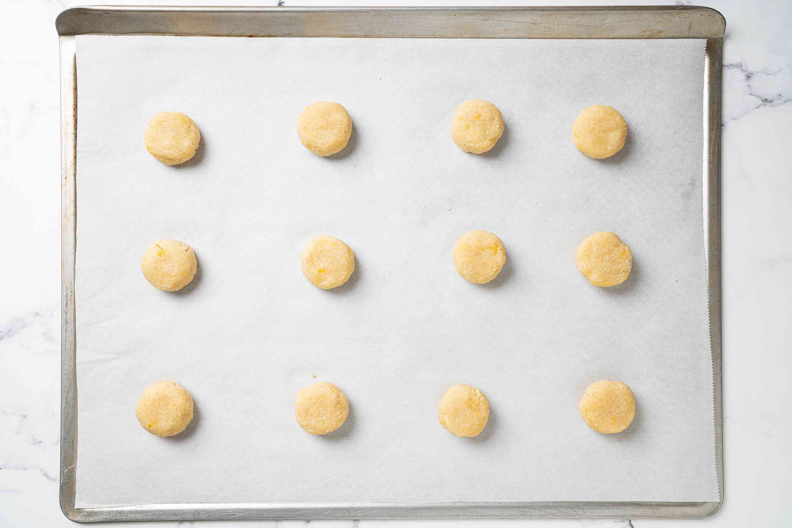 Keto Shortbread Cookies rolled onto parchment lined baking sheet