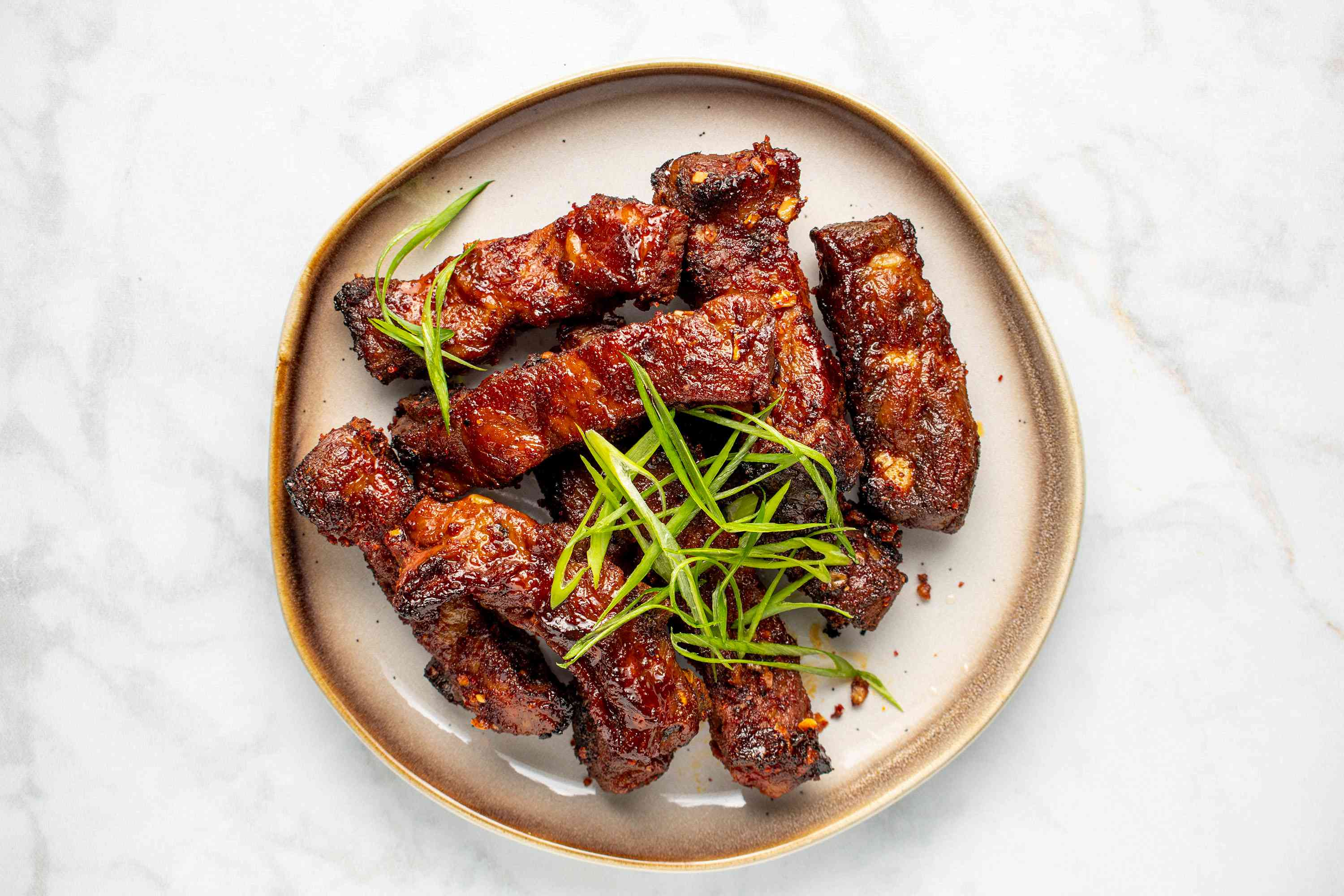 Korean Sweet and Spicy Pork Spareribs on a plate