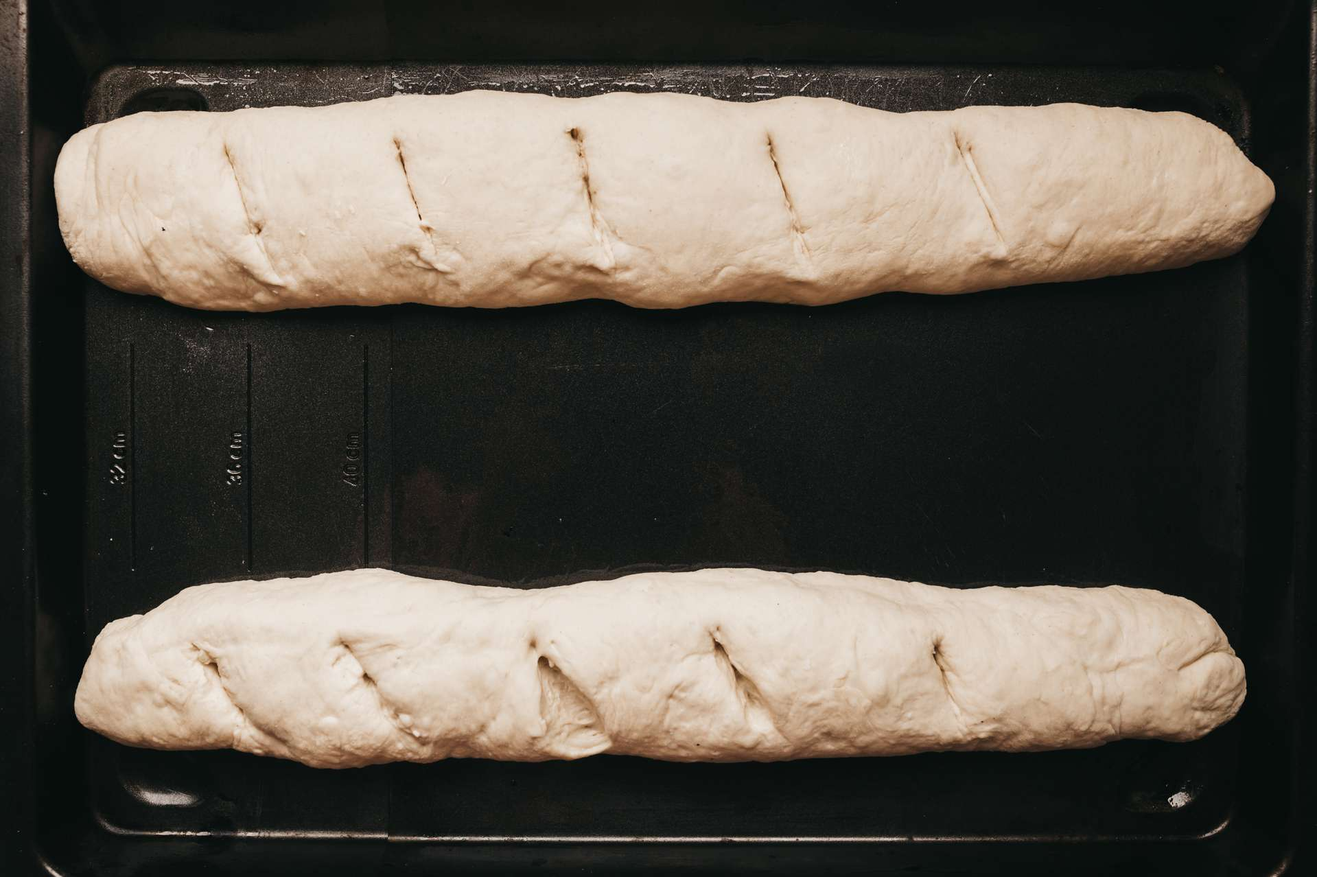 Place loaves onto lightly greased baking sheet