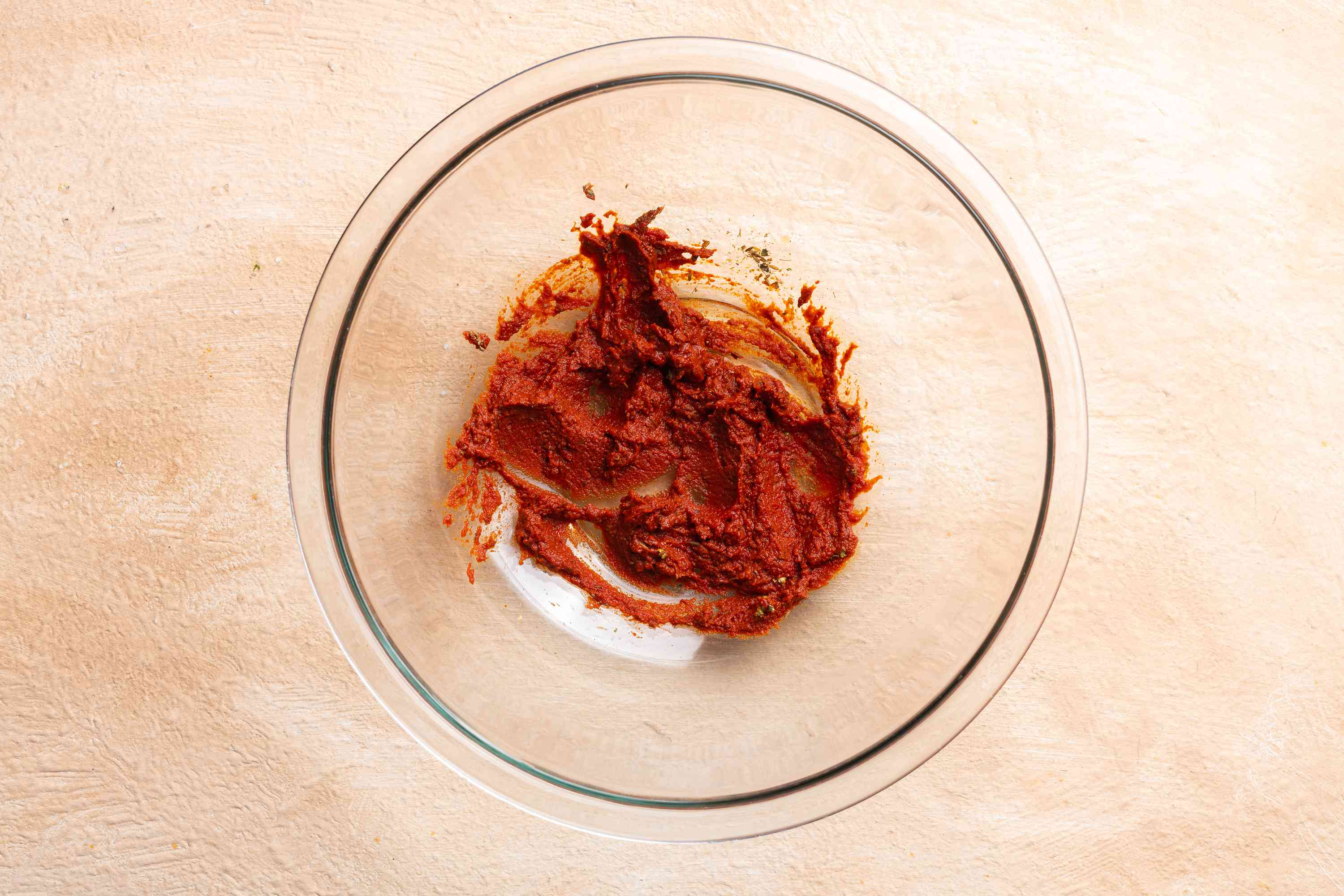 Place chipotle paste, ground cumin, oregano, cloves, and tomato paste in a large bowl