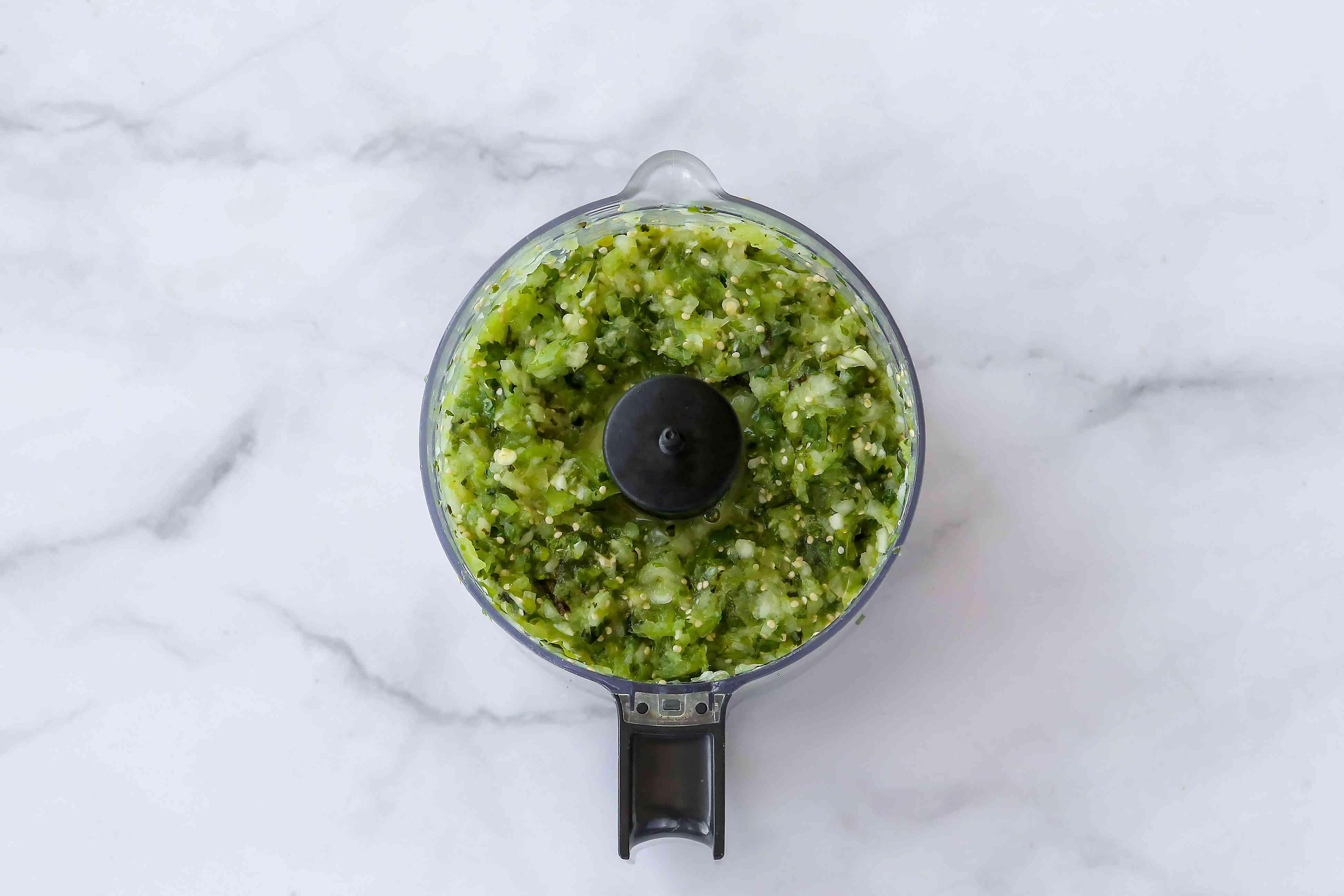 Salsa Verde ingredients in a food processor