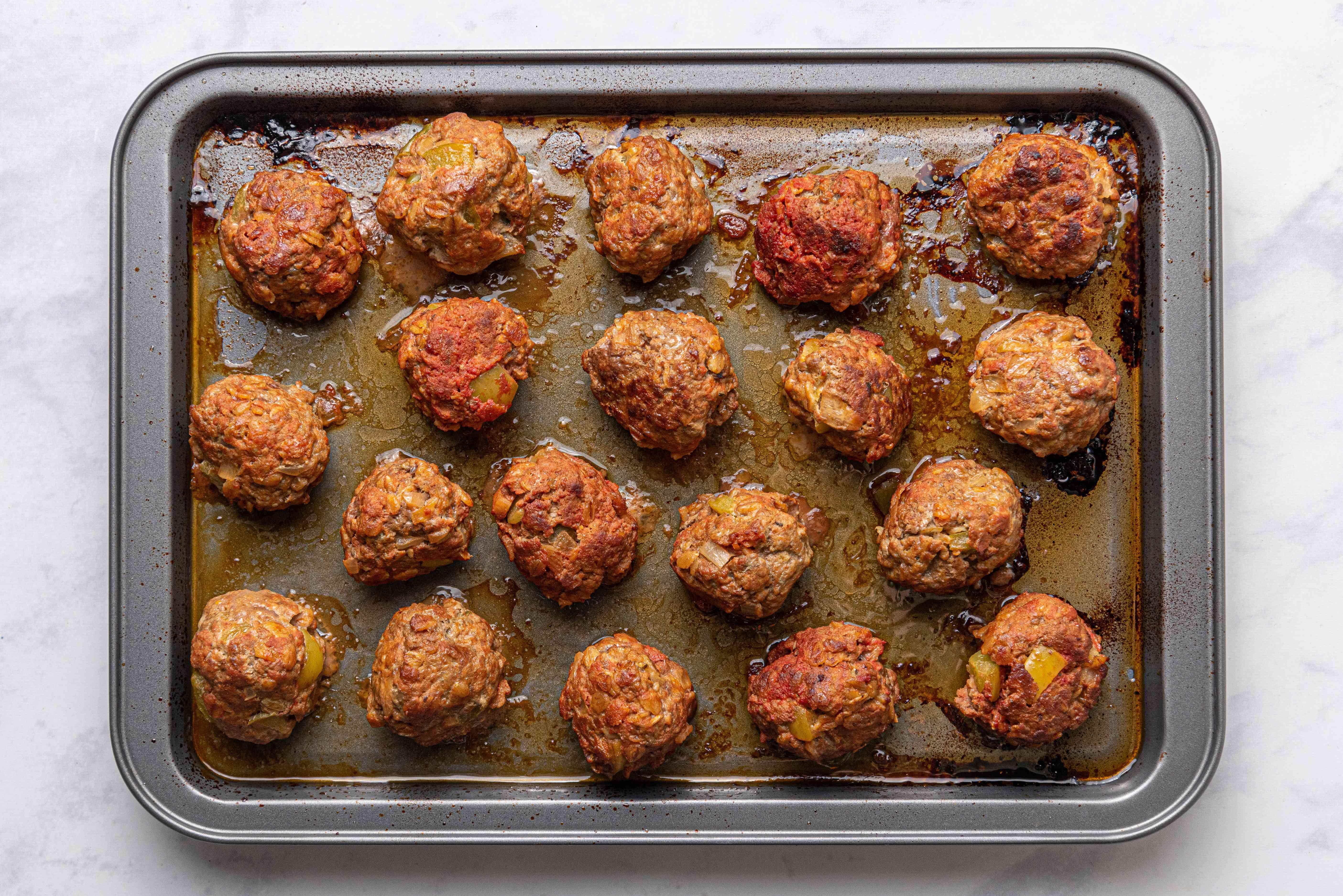 baked meatballs on a baking sheet