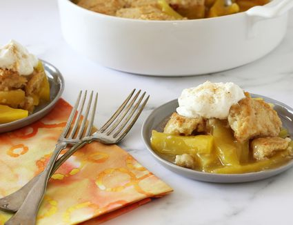Mango cobbler with whipped cream