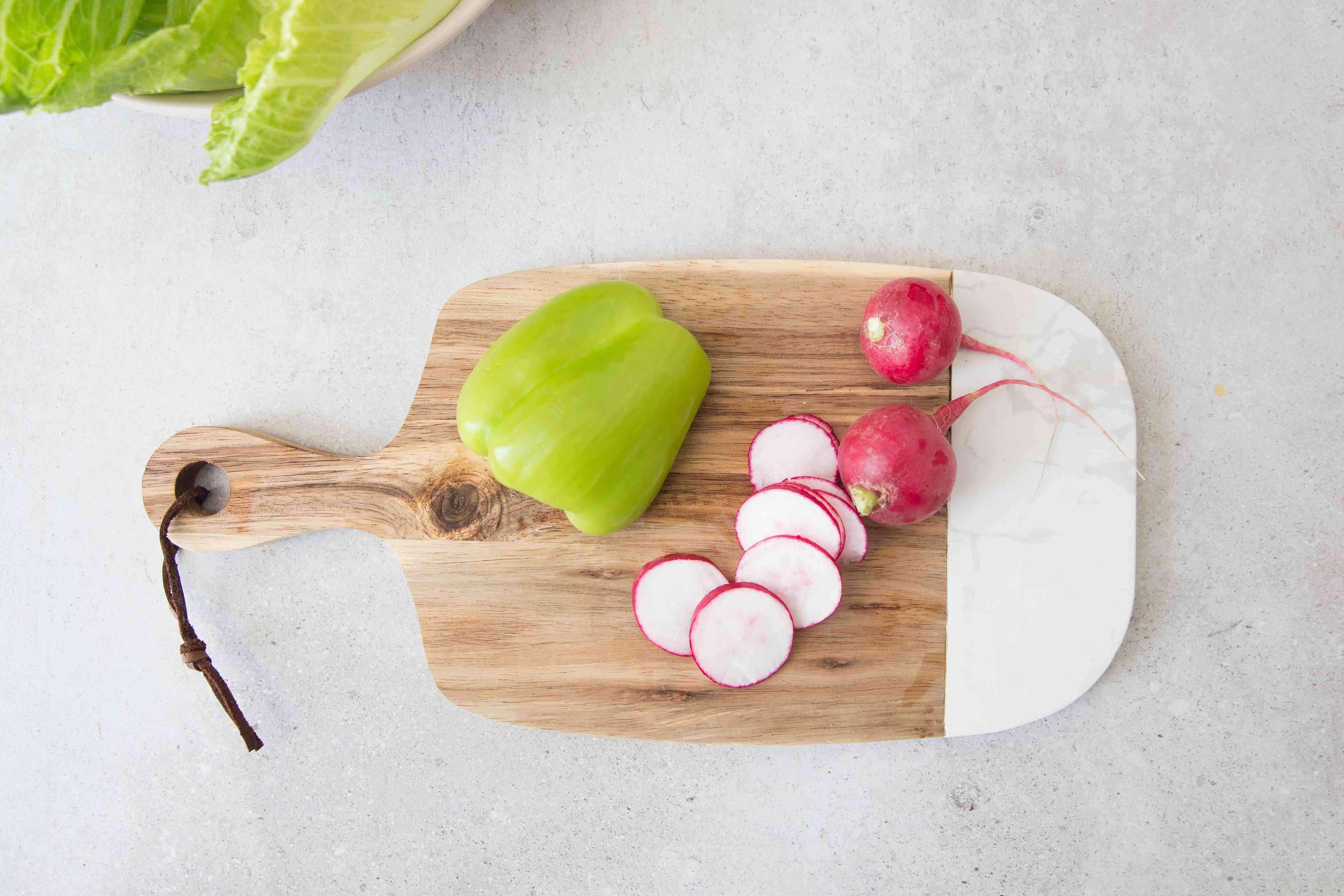 Thinly slice radishes
