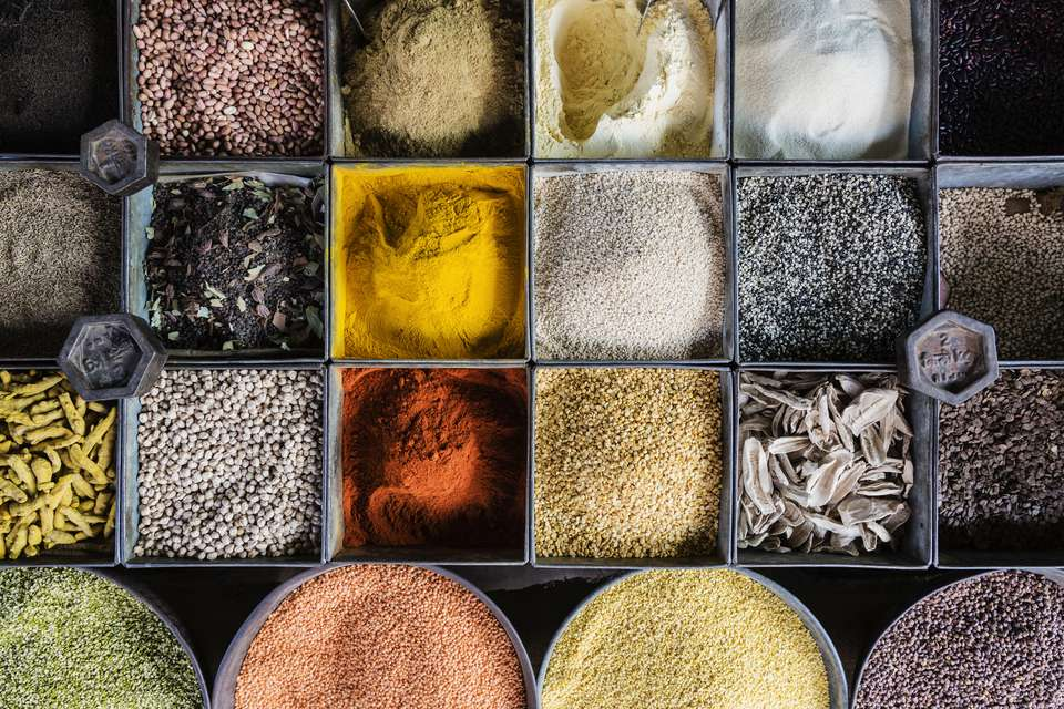 Variety of spices and lentils in market