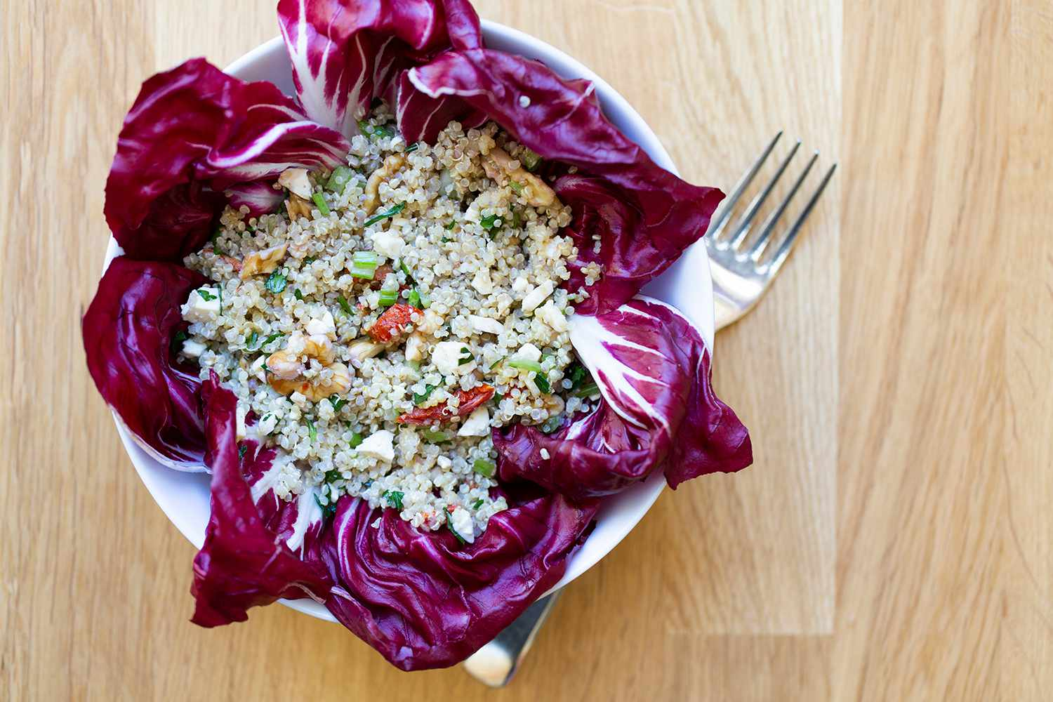 A lunch salad of quinoa, radicchio, walnuts, celery, parsley and tomatoes.