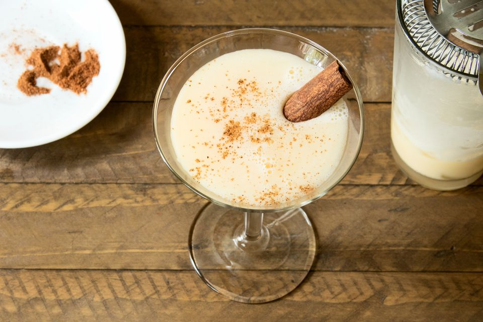 Garnishing an Eggnog Martini With Cinnamon and Nutmeg