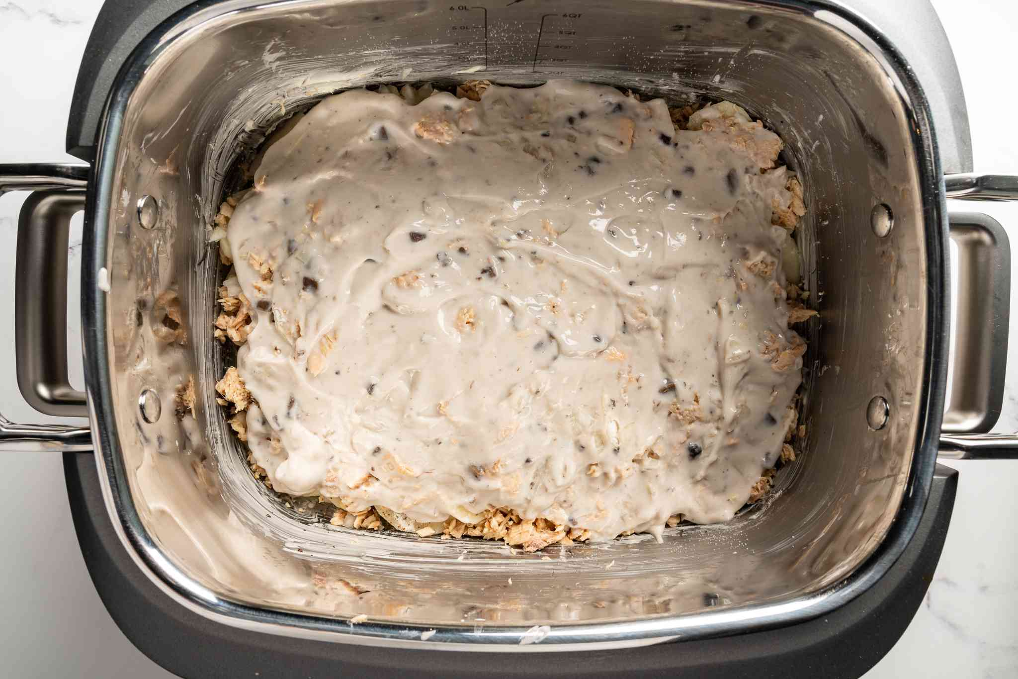 Pour the soup mixture over the top of potato and salmon mixture in the crock pot