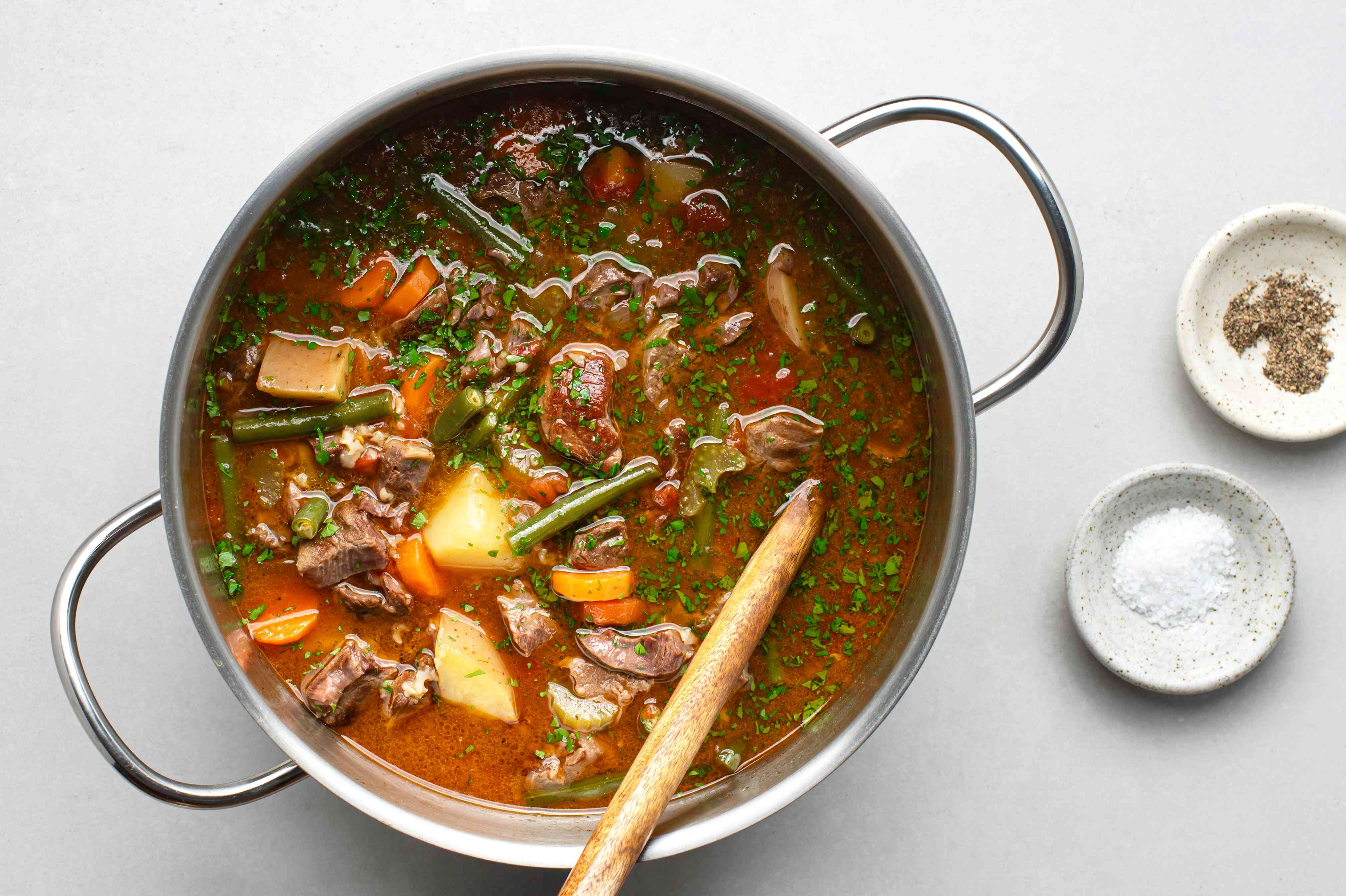 Old-Fashioned Vegetable Beef Soup, with parsley, salt and pepper