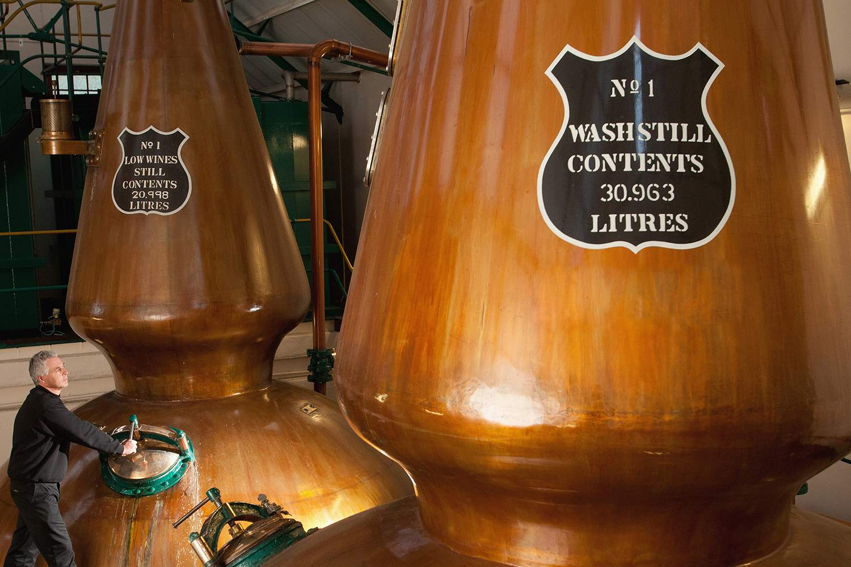 Copper pot stills at a Scotch Distillery in Scotland
