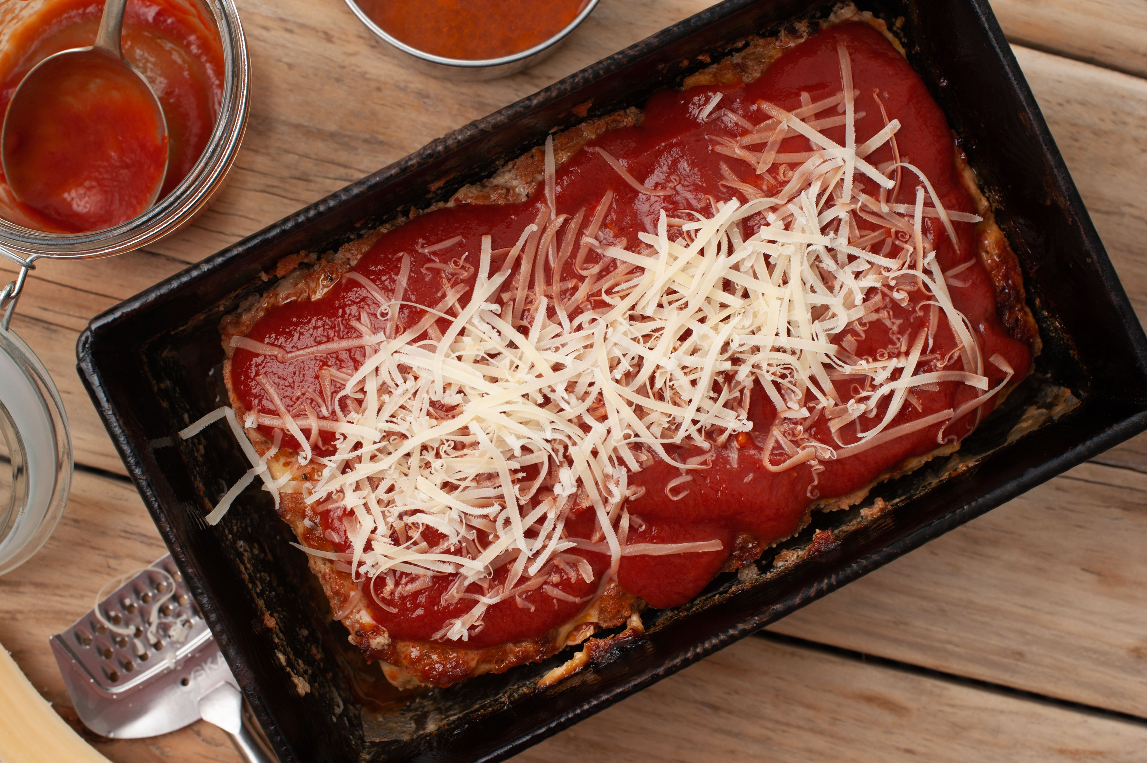 Pour cheese on meatloaf
