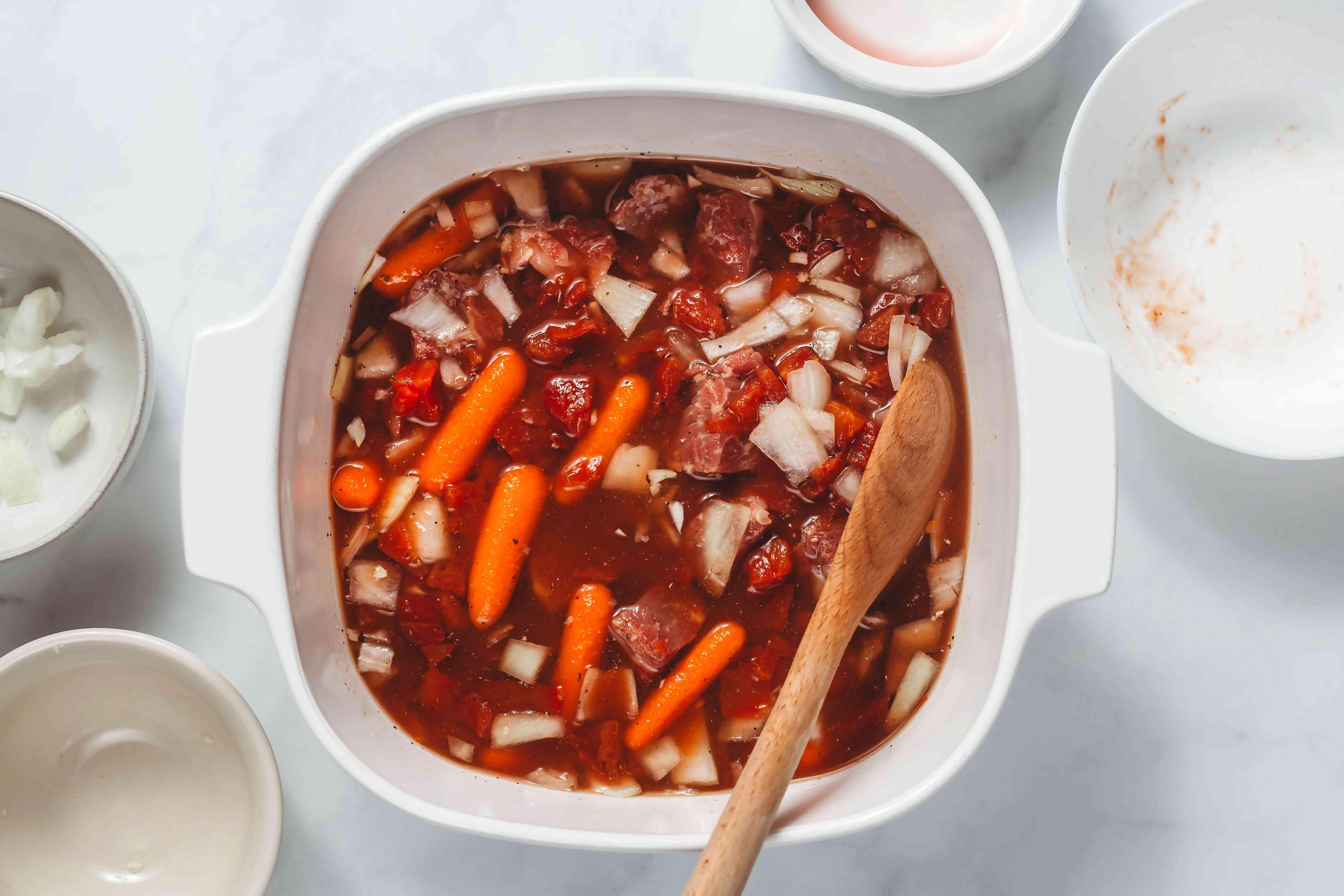 beef stew ingredients in a Crockpot