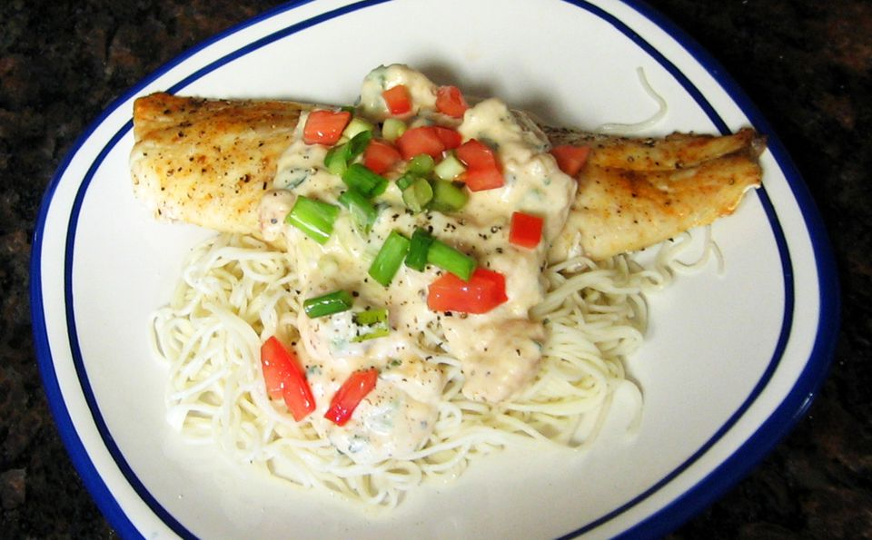 Red snapper with cream shrimp sauce on plate