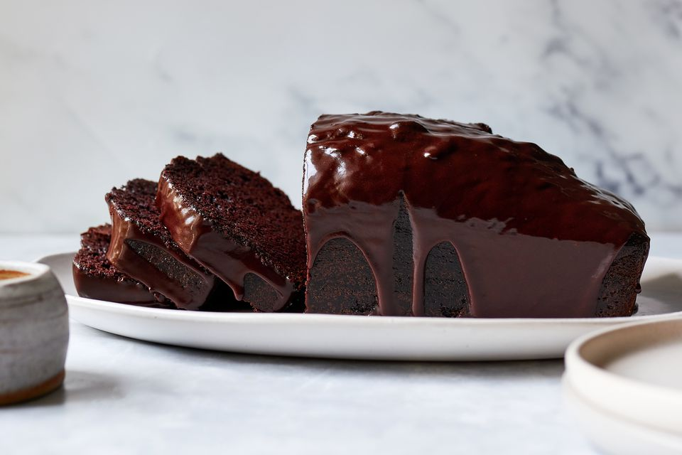 Chocolate Loaf Cake With Easy Chocolate Glaze recipe, on a white plate