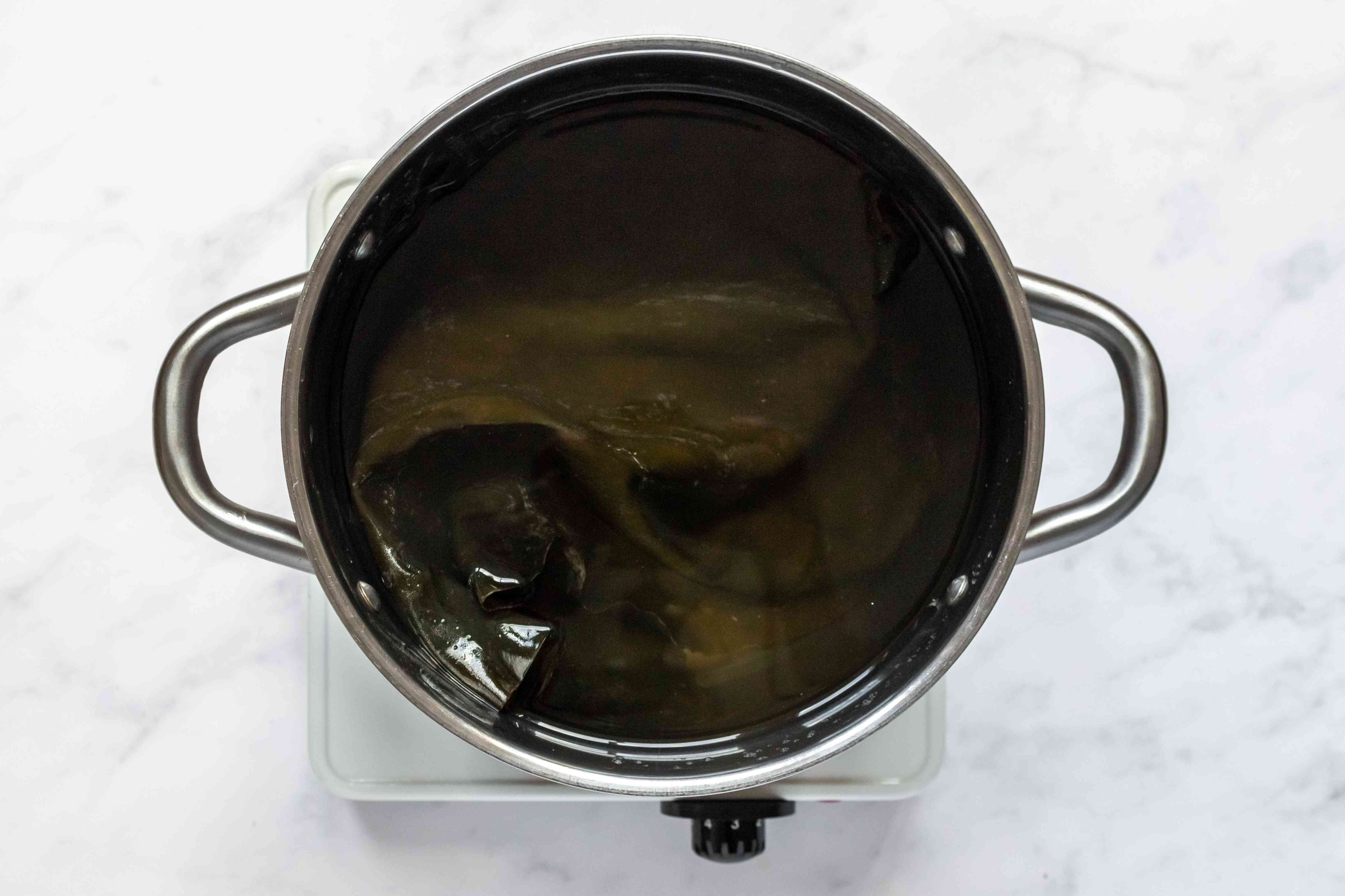 konbu and water cooking in a pot
