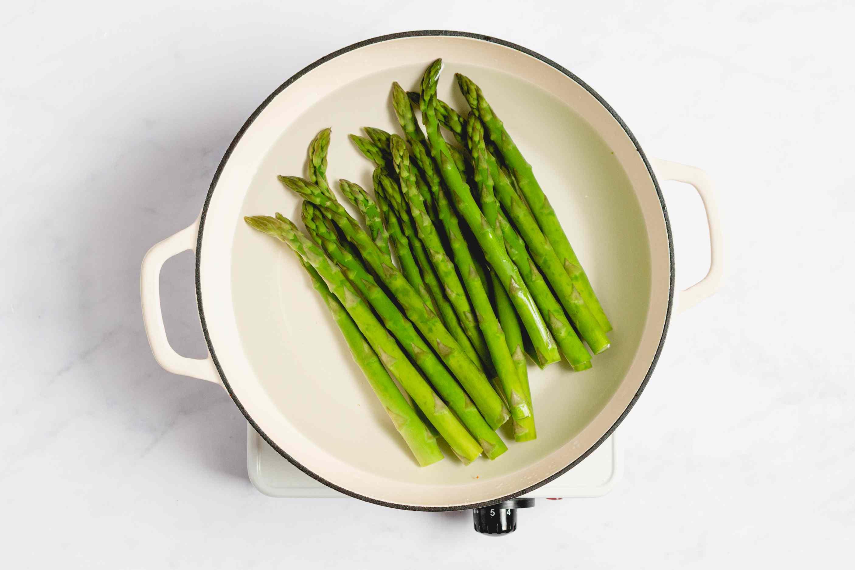 Asparagus cooking in saucepan