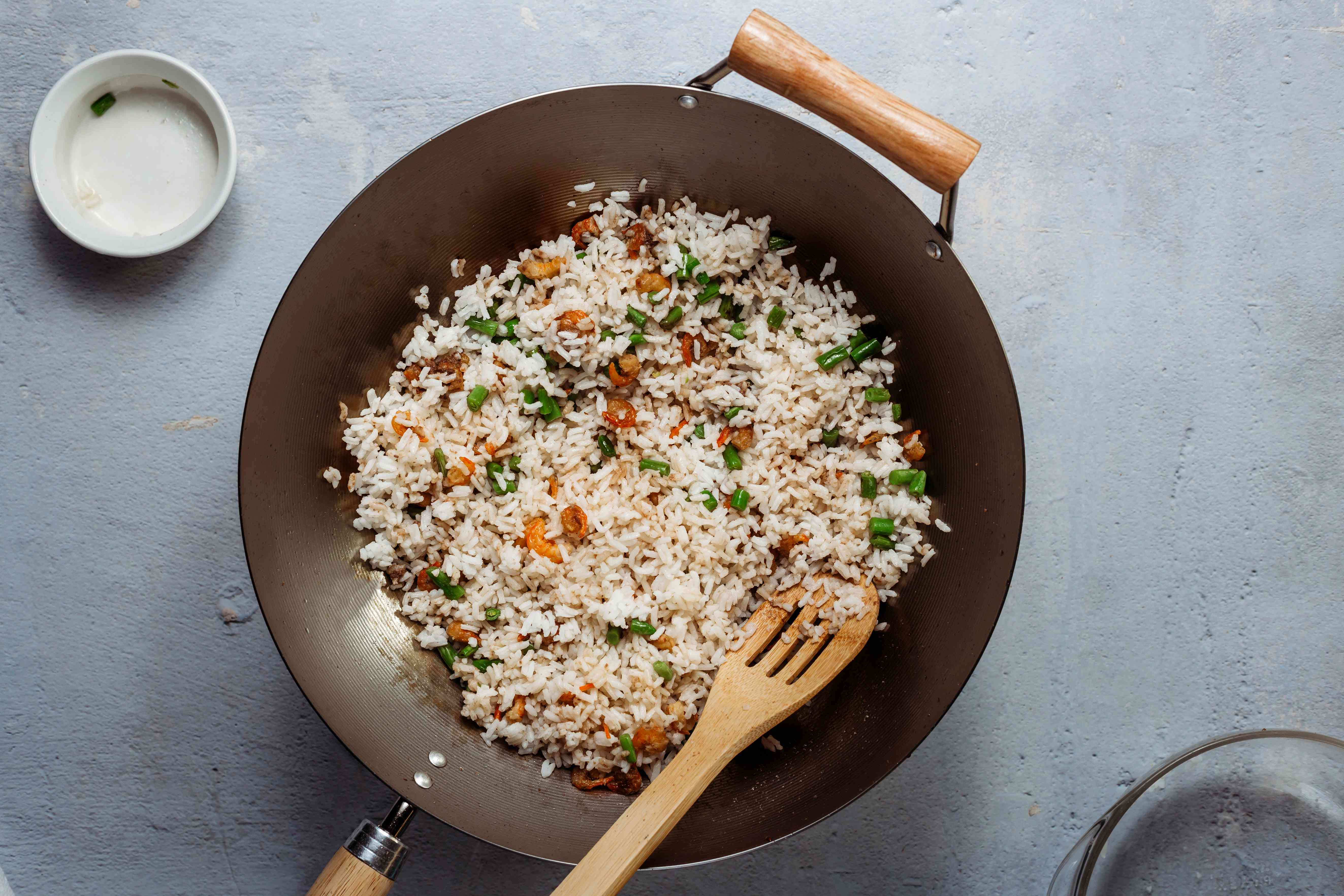 add rice to the shrimp mixture in the wok