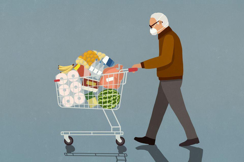 Man pushing a shopping cart wearing a face mask