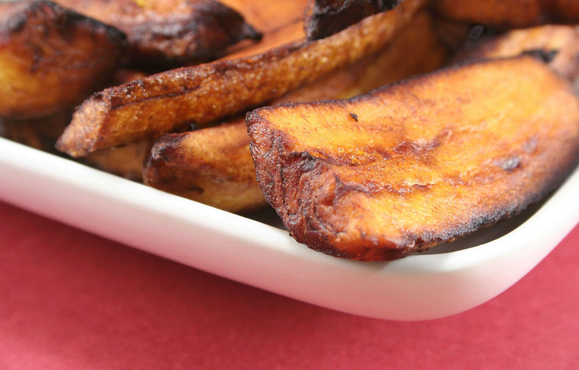 Fried plantain strips in a baking dish