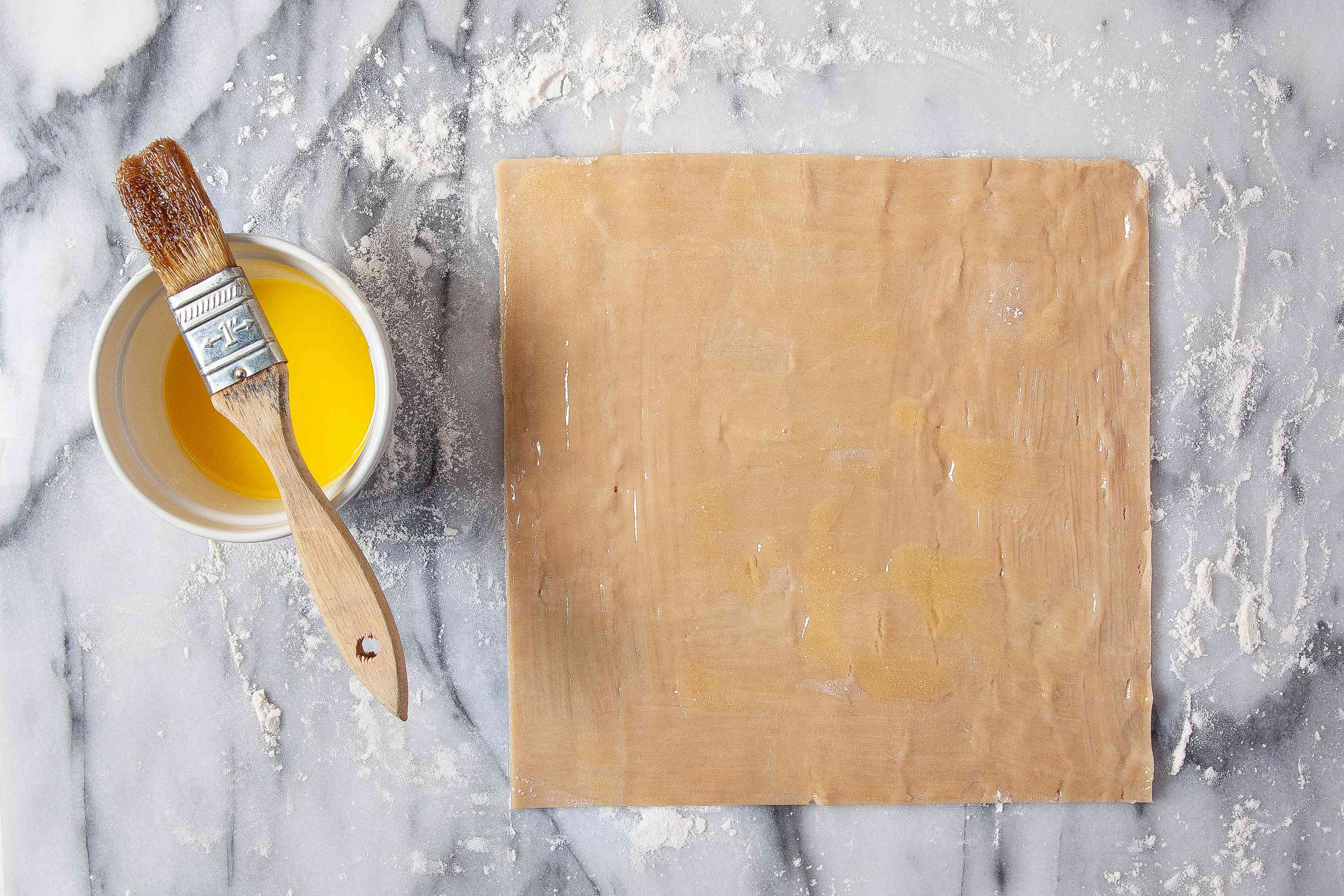 Pie crust brushed with melted butter