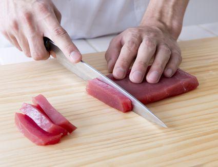 Cutting sashimi - stock photo