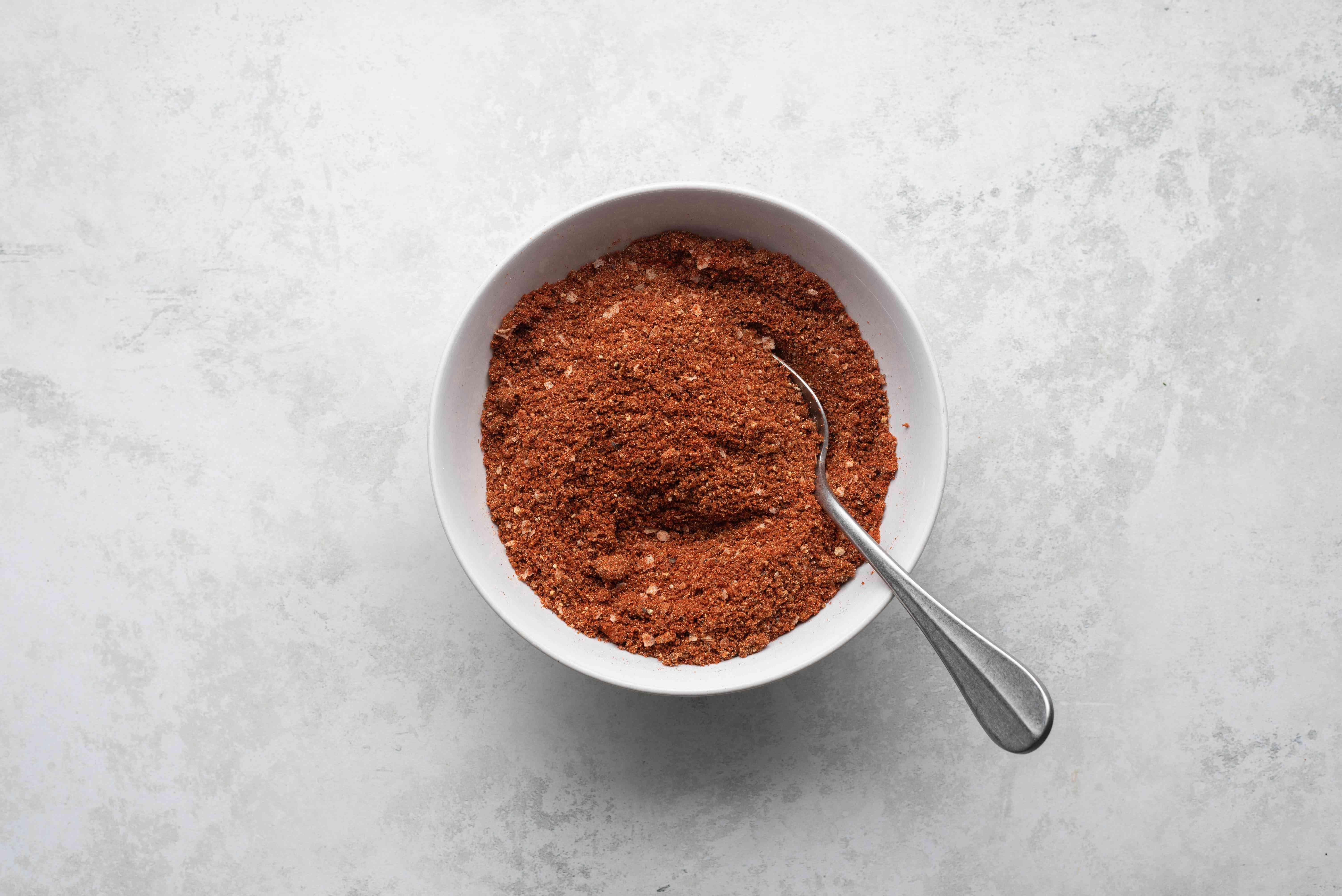 dark-brown sugar, paprika, salt, black pepper, white pepper, garlic powder, onion powder, and cayenne pepper in a small bowl
