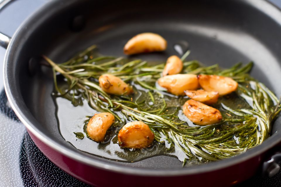 Garlic and rosemary in pan