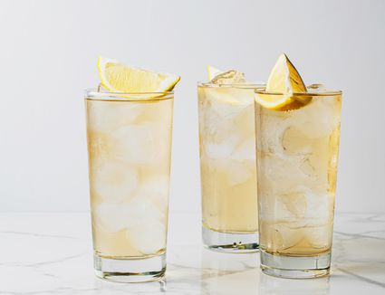 Three glasses of gin buck cocktail recipe with lemon garnishes