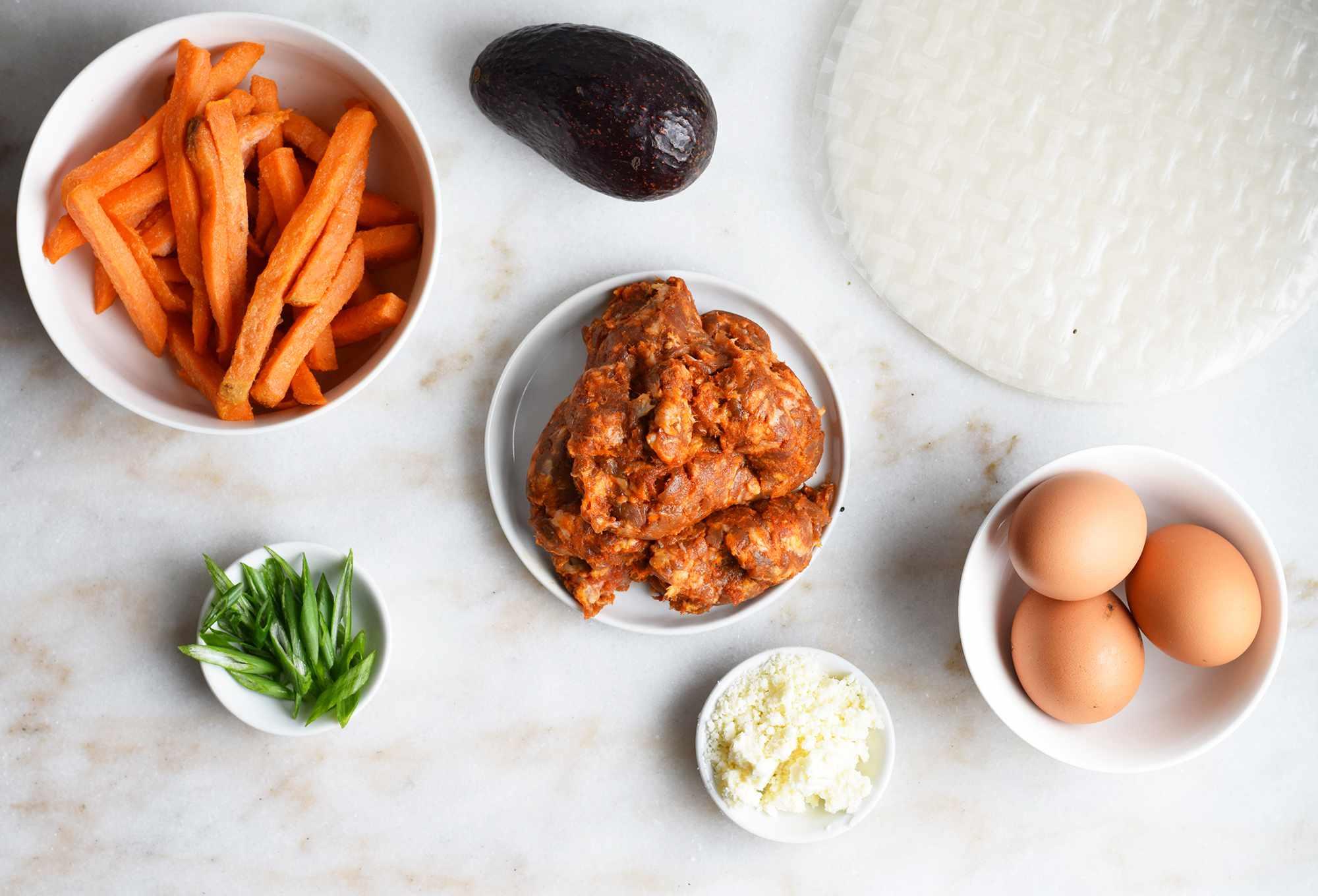 savory breakfast summer roll ingredients on marble board