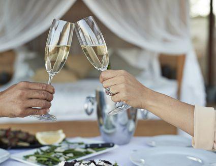 Couple having private romantic dinner in luxury cabin