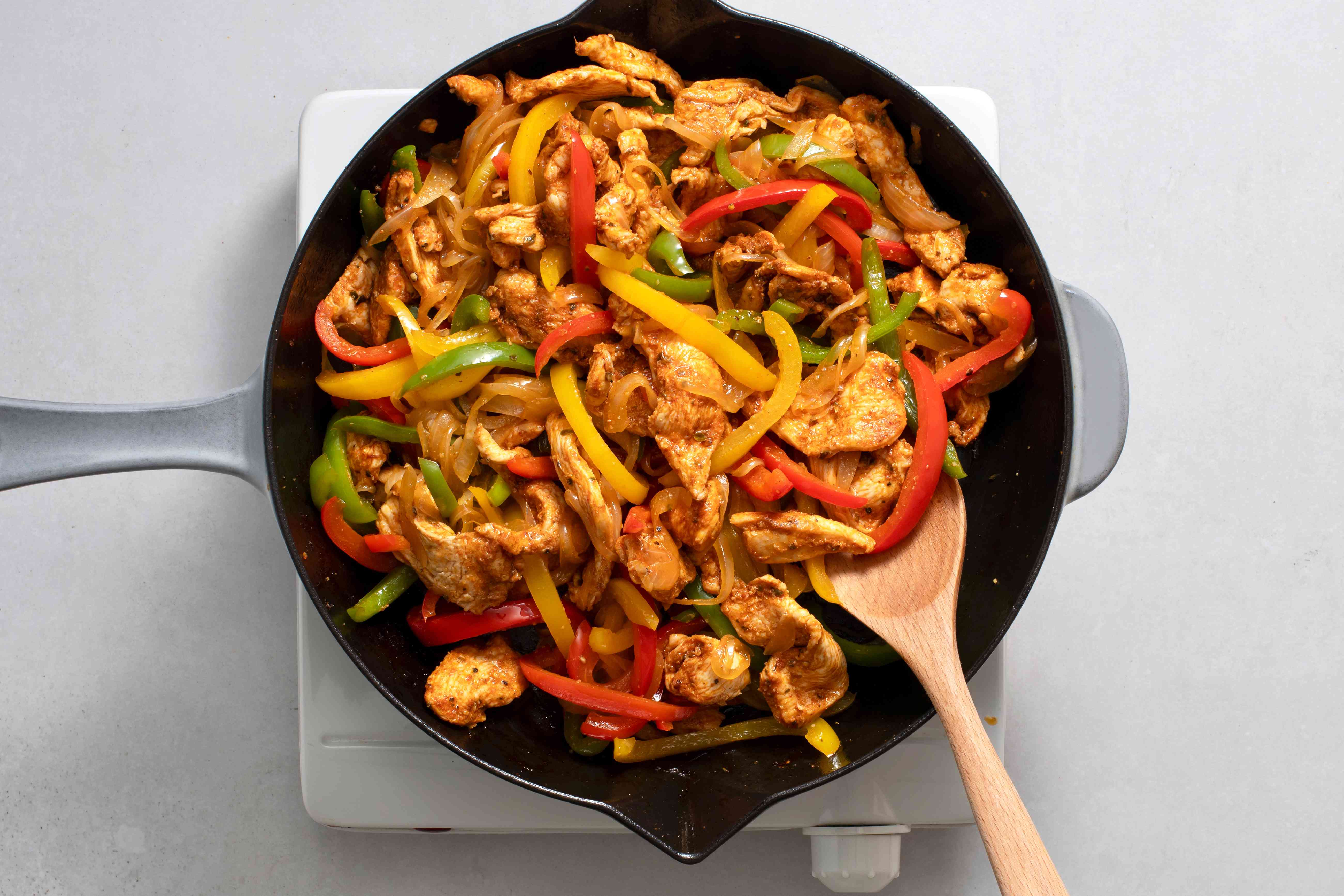 chicken and peppers in a cast iron skillet