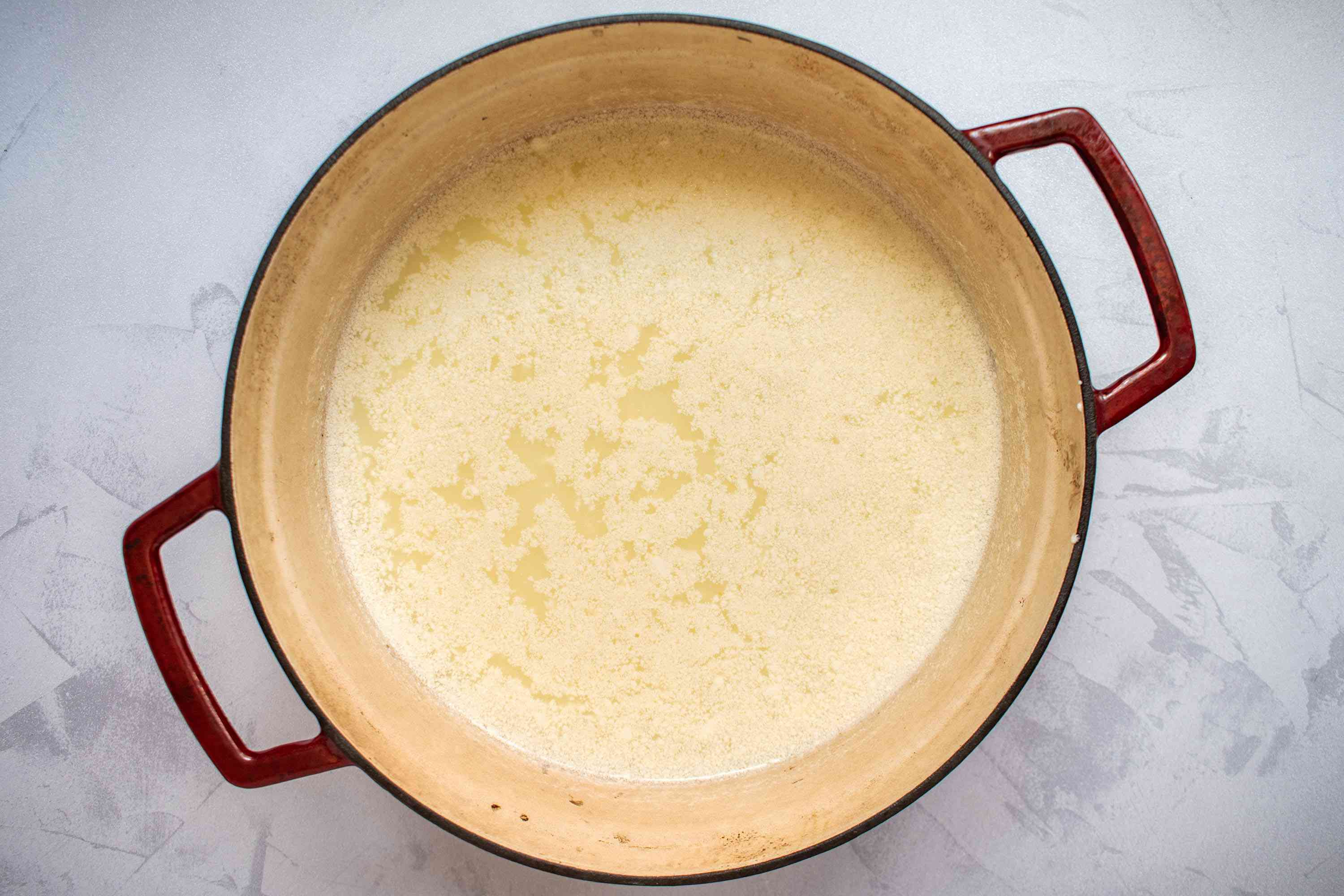 vinegar added to the milk, whipping cream, buttermilk, and salt mixture, in a large pot