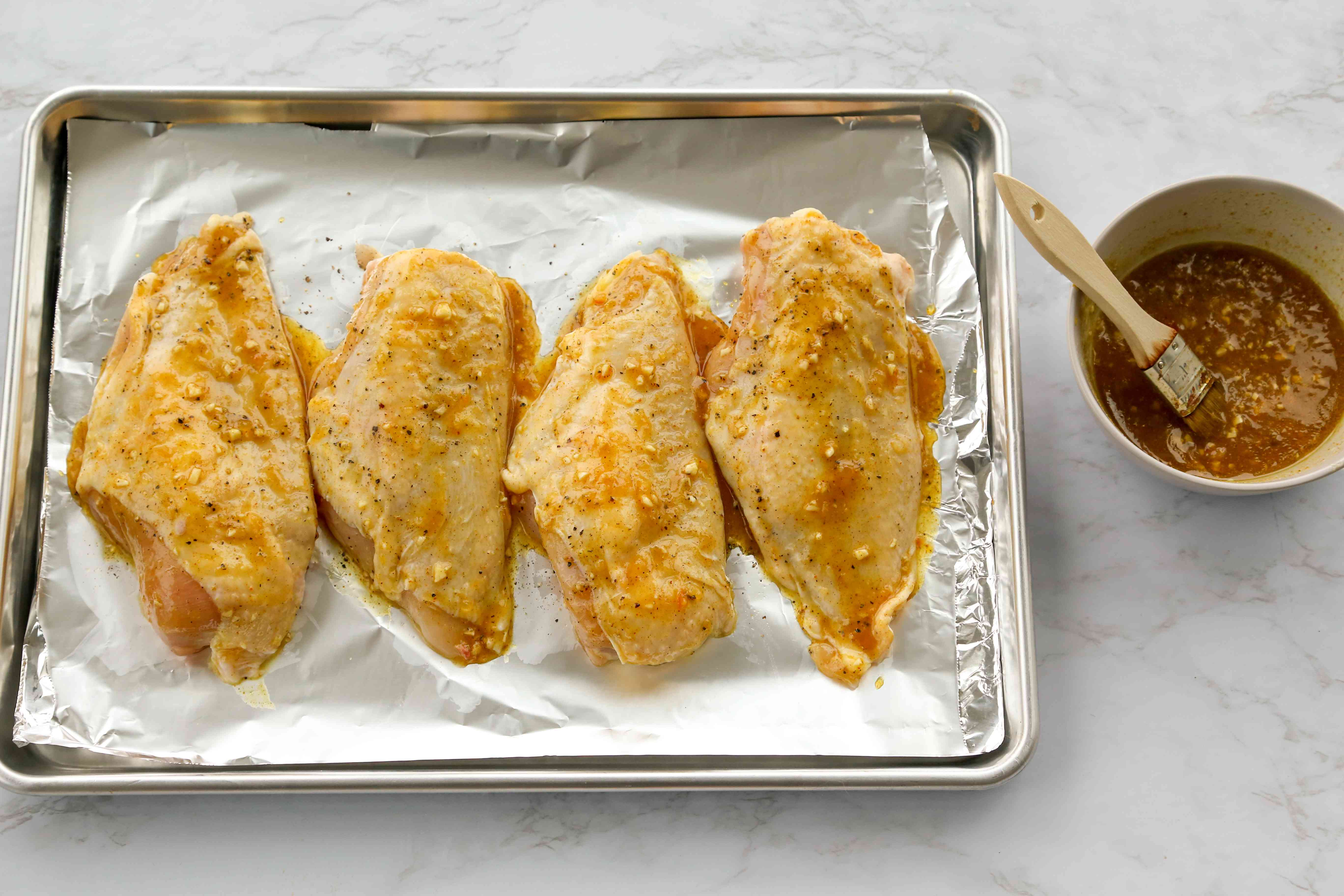 Coat the chicken pieces with the marmalade mixture