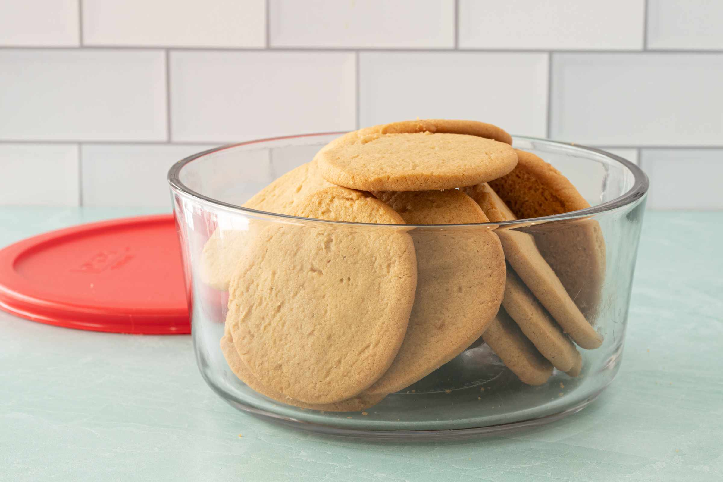 Peanut butter cookies in a storage bowl.